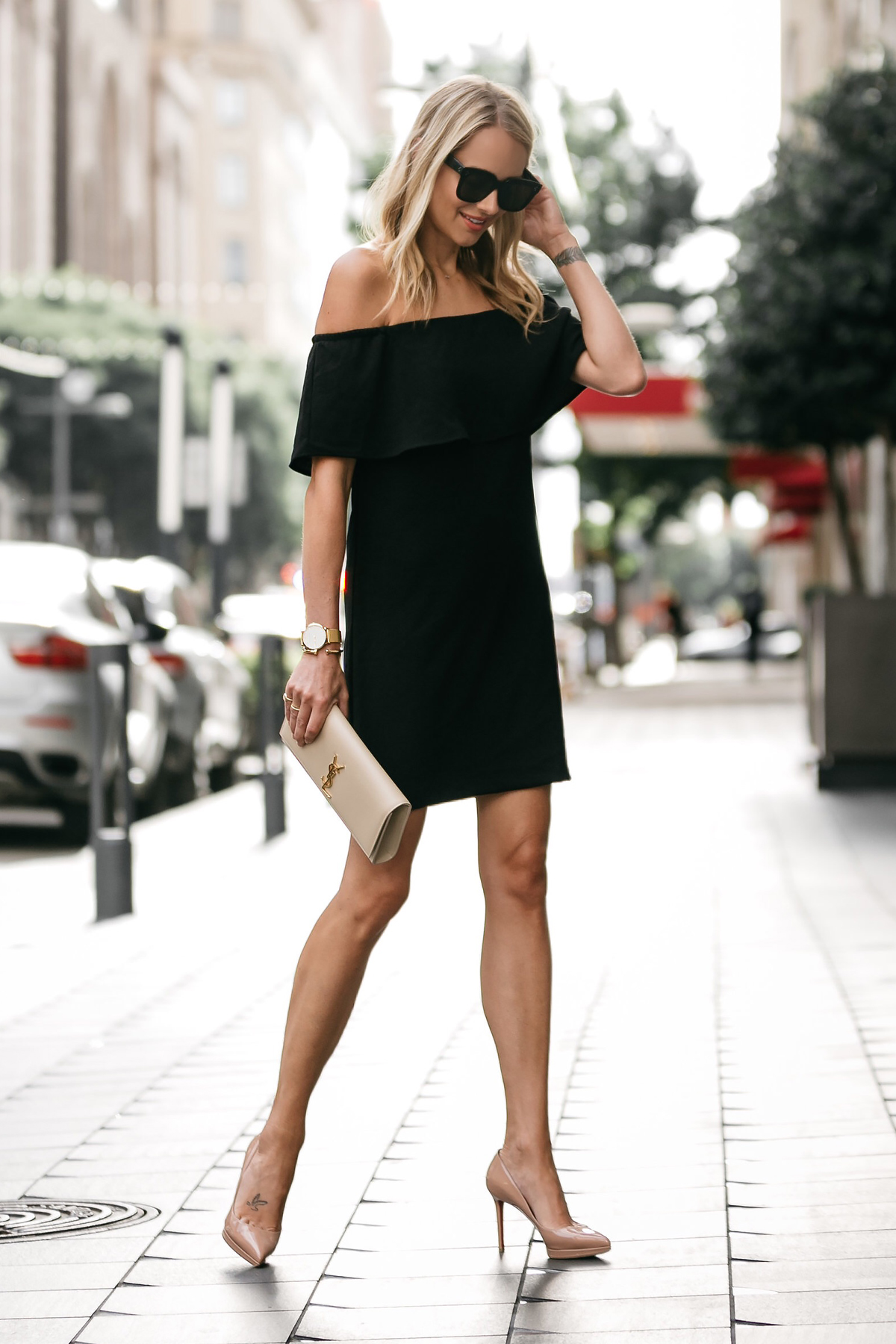 Blonde woman wearing Nordstrom off the shoulder black dress YSL nude clutch christian louboutin nude pumps little black dress street style dallas blogger fashion blogger