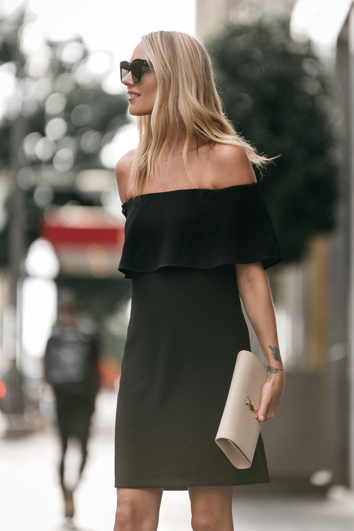 Blonde woman wearing Nordstrom off the shoulder black dress YSL nude clutch little black dress street style dallas blogger fashion blogger