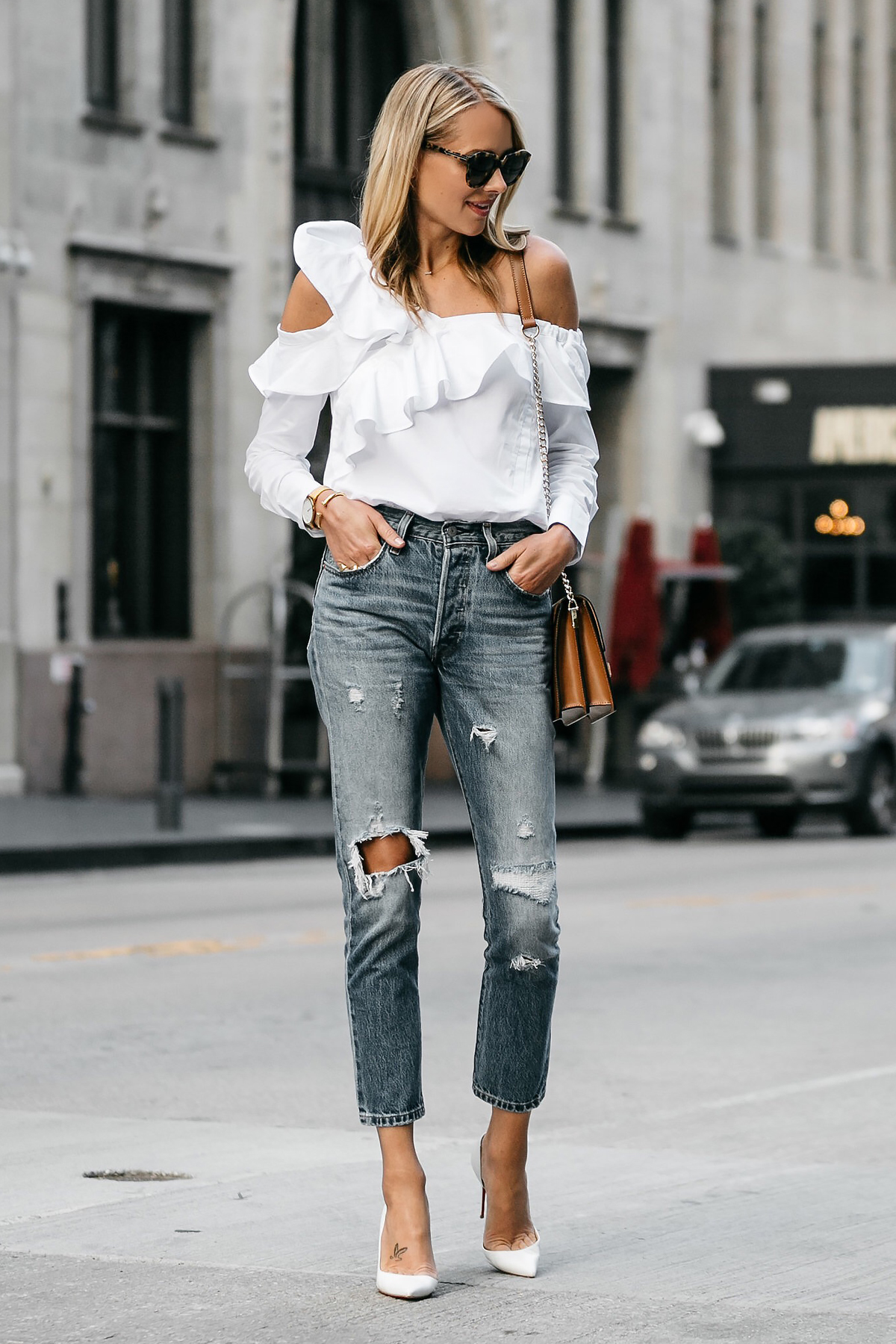 Blonde Woman Wearing Shopbop White Asymmetrical Ruffle Top Levis Denim Ripped Skinny Jeans Christian Louboutin White Pumps Street Style Dallas Blogger Fashion Blogger