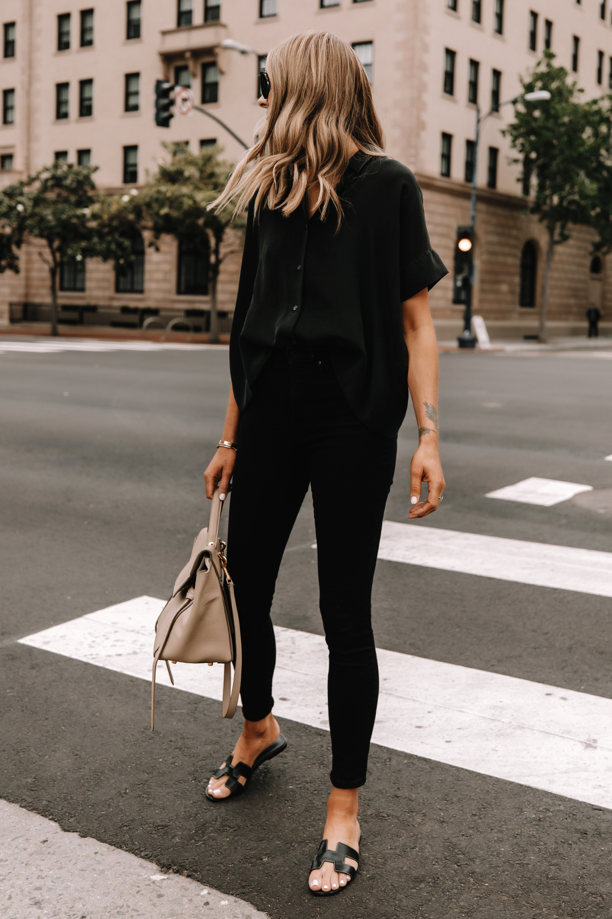 Fashion Jackson Wearing Everlane Black Button Down Shirt Everlane Black Skinny Jeans Hermes Oran Black Sandals Celine Belt Bag Street Style