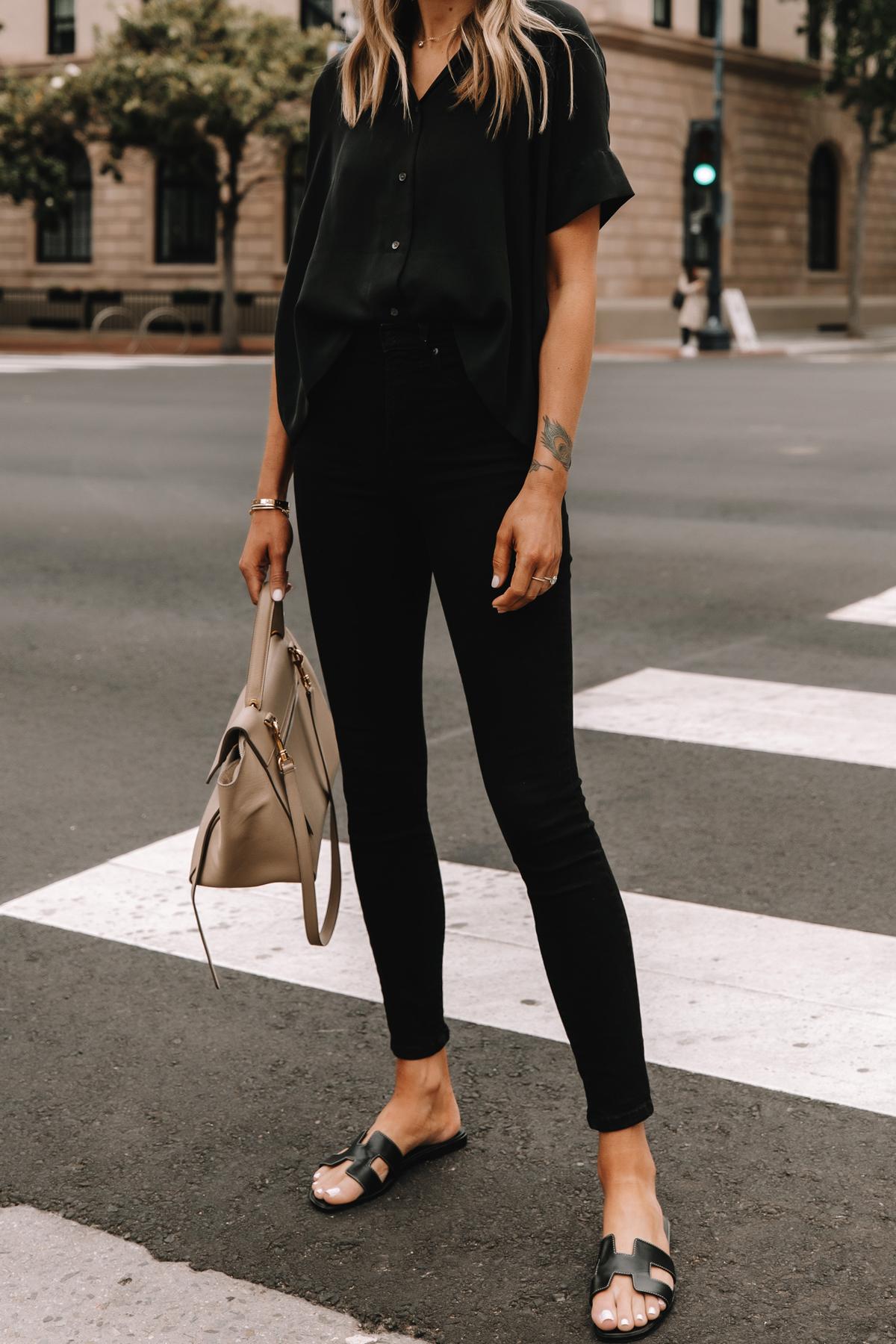 Fashion Jackson Wearing Everlane Black Button Down Shirt Everlane Black Skinny Jeans Hermes Oran Black Sandals Celine Belt Bag