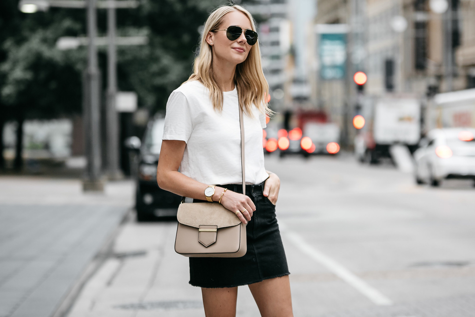 Blonde woman wearing white tshirt frame black denim mini skirt outfit tan crossbody street style dallas blogger fashion blogger