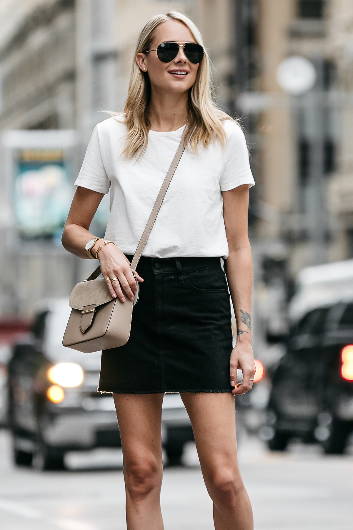 Blonde Woman wearing white tshirt frame black denim skirt outfit tan crossbody street style dallas blogger fashion blogger