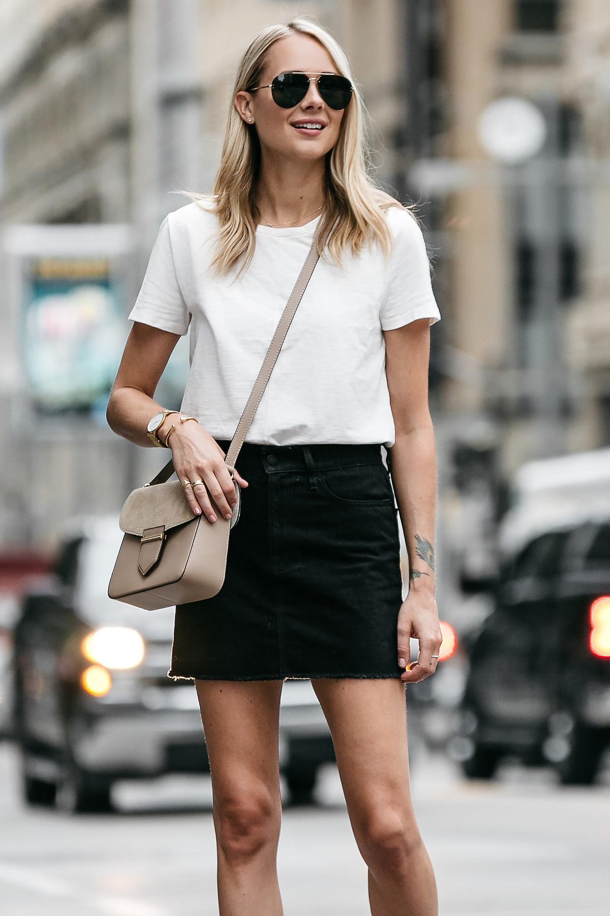 Blonde Woman wearing white tshirt frame black denim skirt outfit tan crossbody street style dallas blogger fashion blogger