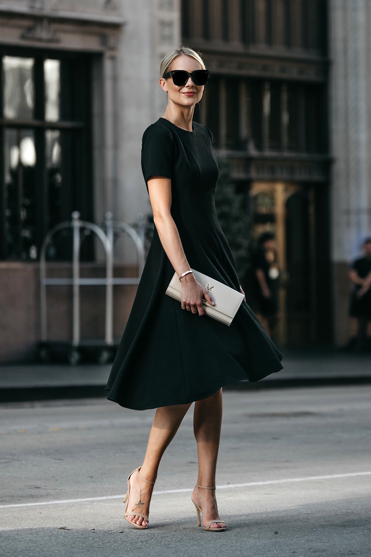 Blonde Woman Wearing Black Halo Asymmetrical Little Black Dress Steve Madden Stecy Ankle Strap Heels Saint Laurent Nude Clutch Fashion Jackson Dallas Blogger Fashion Blogger Street Style
