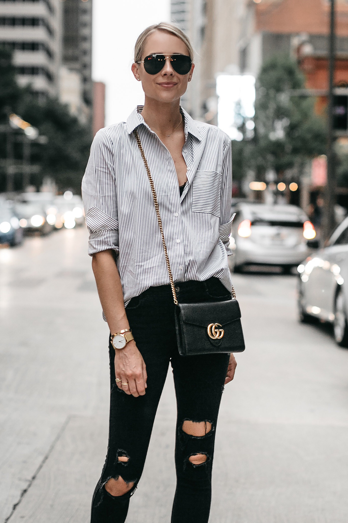 3a81fd0993 Blonde Woman Wearing Black White Striped Button Down Shirt Gucci Handbag  Black Ripped Skinny Jeans Fashion