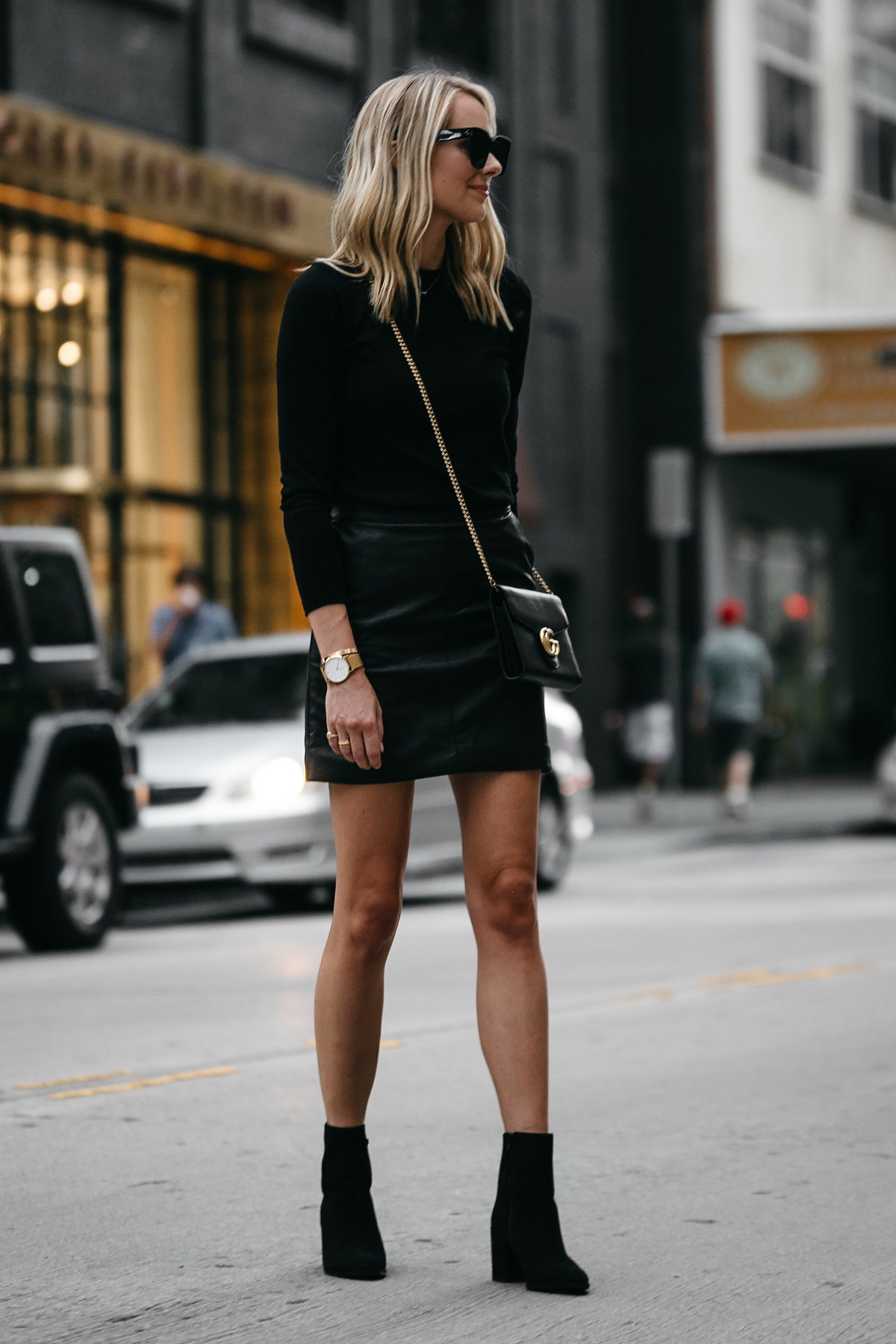 Blonde Woman Wearing Club Monaco Black Sweater Topshop Black Leather Mini Skirt Outfit Gucci Marmont Handbag Stuart Weitzman Black Booties Fashion Jackson Dallas Blogger Fashion Blogger Street Style