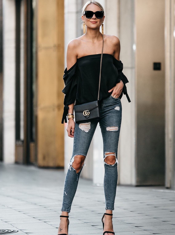 4d896053bda0 Blonde Woman Wearing Club Monaco Black Off-the-Shoulder Top Denim Ripped  Skinny Jeans