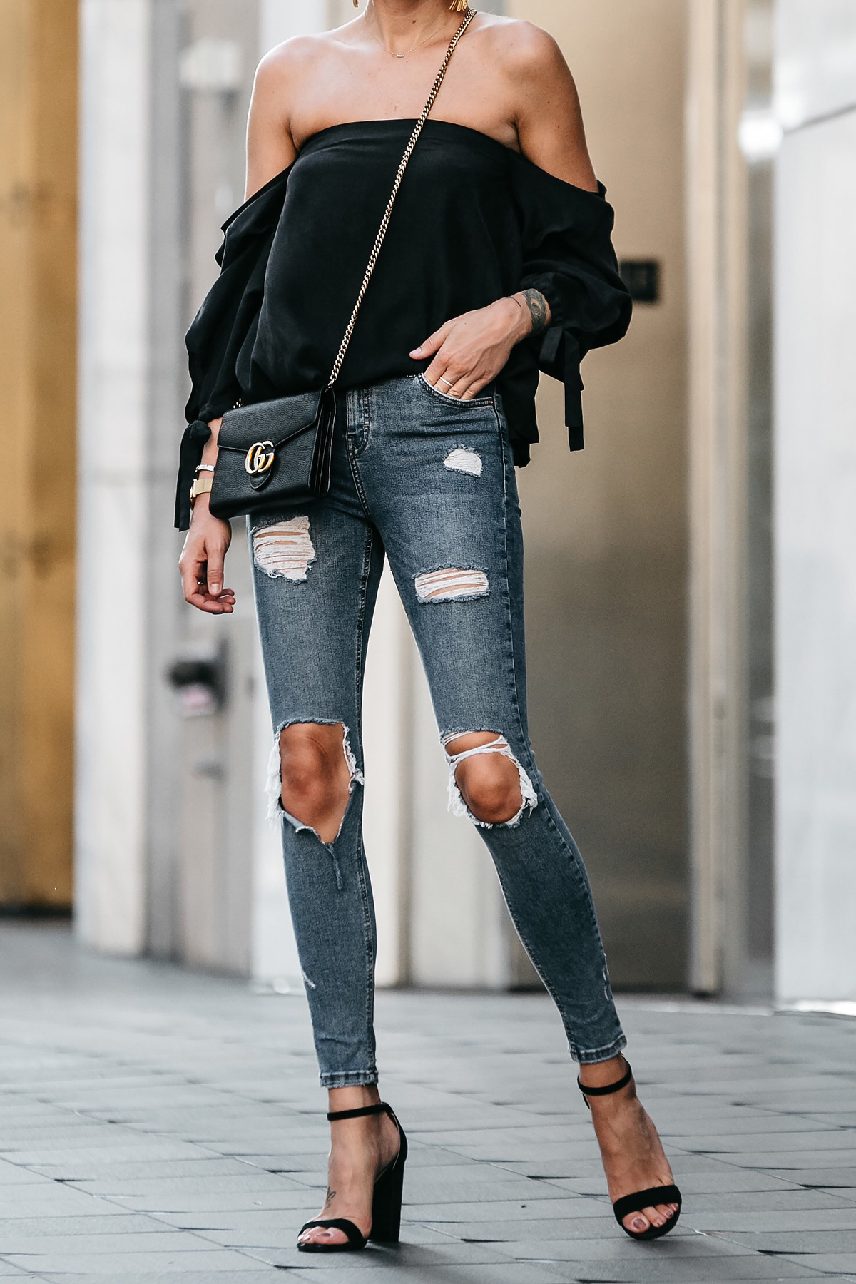 Club Monaco Black Off-the-Shoulder Top Denim Ripped Skinny Jeans Outfit Black Ankle Strap Heeled Sandals Gucci Marmont Handbag