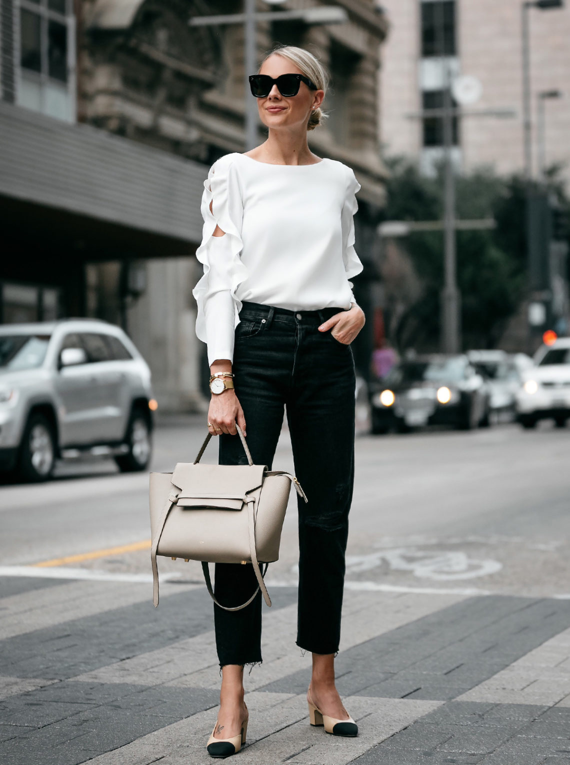 Blonde Woman Wearing Club Monaco White Ruffle Sleeve Top Frame Black Boyfriend Jeans Outfit Celine Belt Bag Chanel Slingbacks Fashion Jackson Dallas Blogger Fashion Blogger Street Style