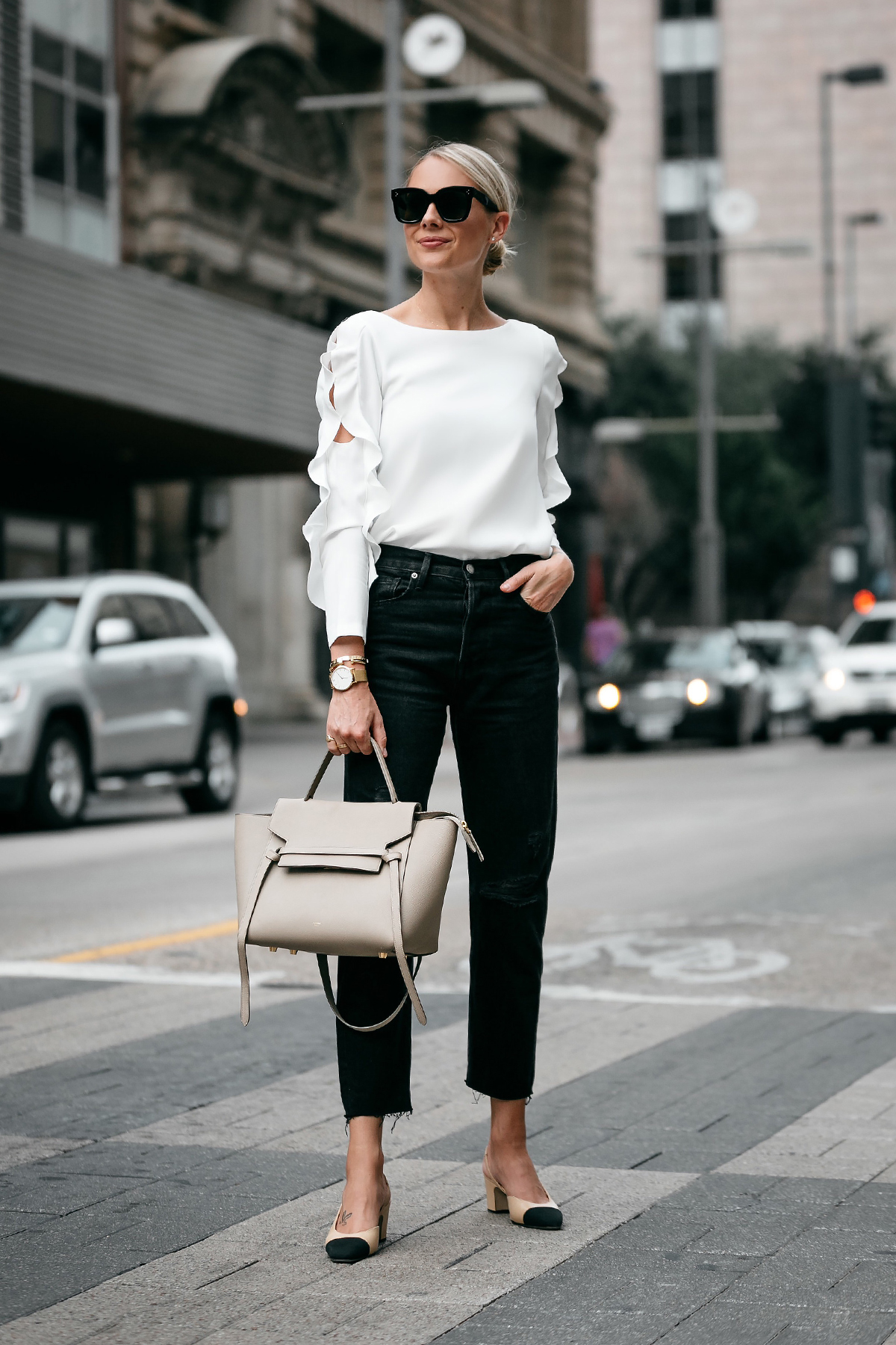 Blonde Woman Wearing Club Monaco White Ruffle Sleeve Top Frame Black Ripped Boyfriend Jeans Outfit Celine Belt Bag Chanel Slingbacks Fashion Jackson Dallas Blogger Fashion Blogger Street Style