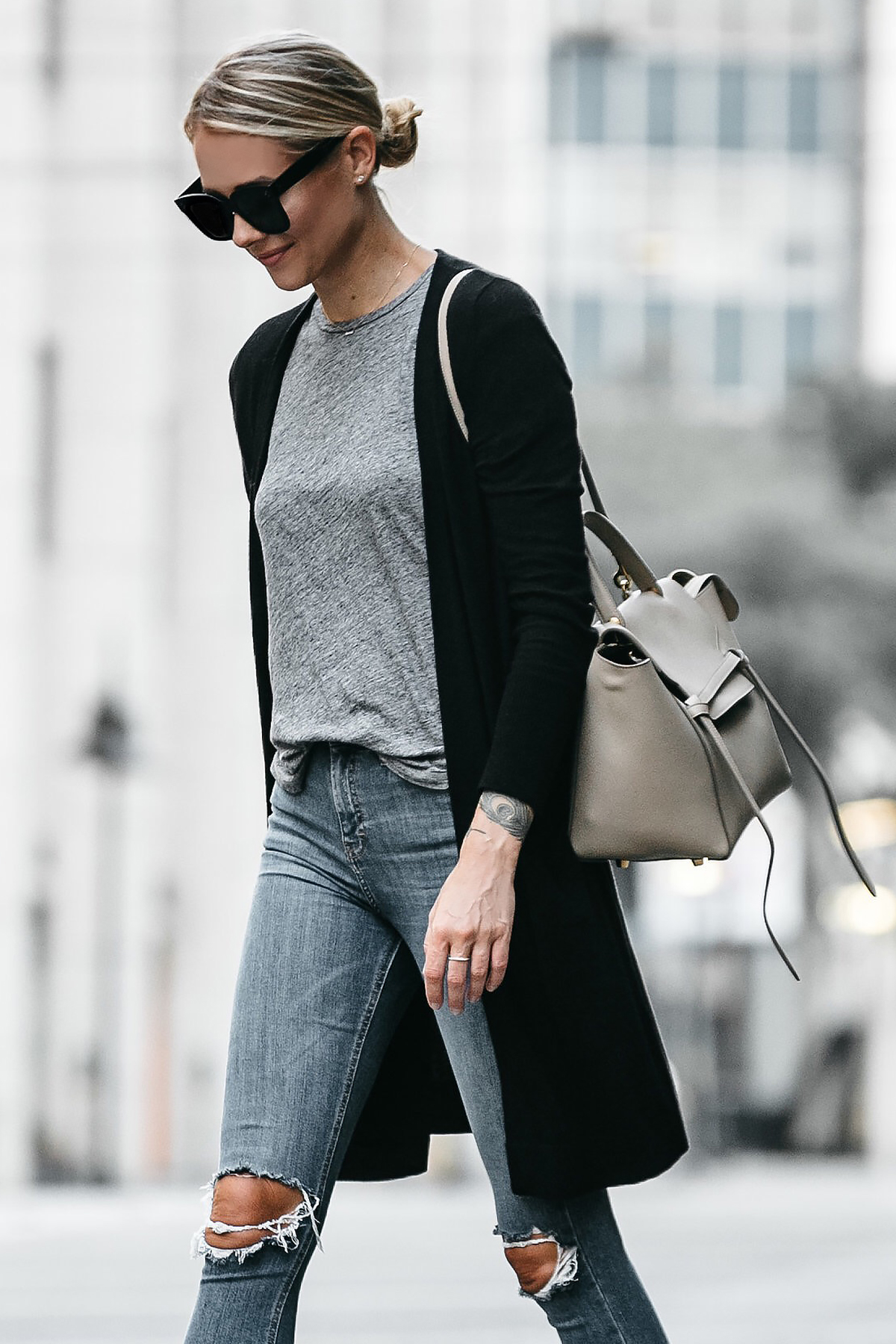 Blonde Woman Wearing Long Black Cardigan Grey Tshirt Topshop Ripped Skinny Jeans Outfit Celine Belt Bag Fashion Jackson Dallas Blogger Fashion Blogger Street Style