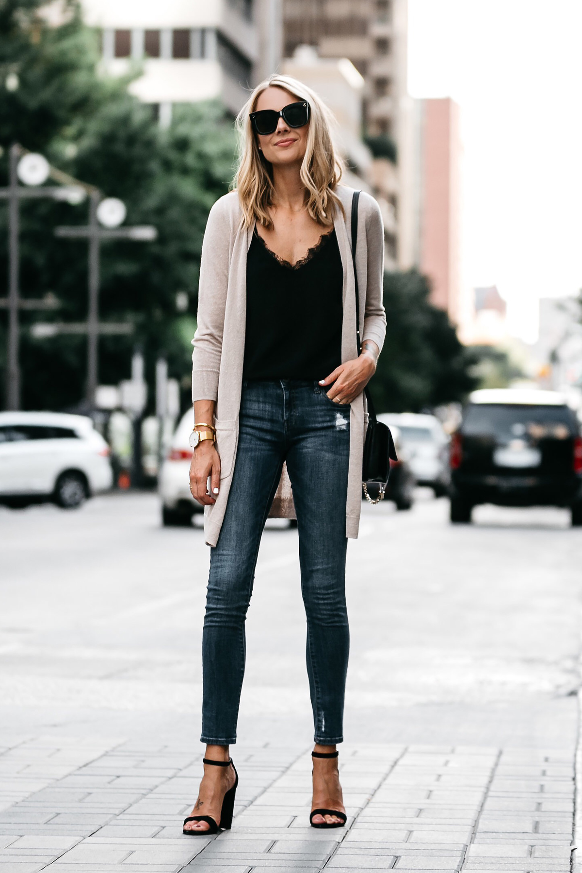 cdfbe60fe8f Blonde Woman Wearing Long Tan Cardigan Black Lace Cami Denim Skinny Jeans  Outfit Black Ankle Strap