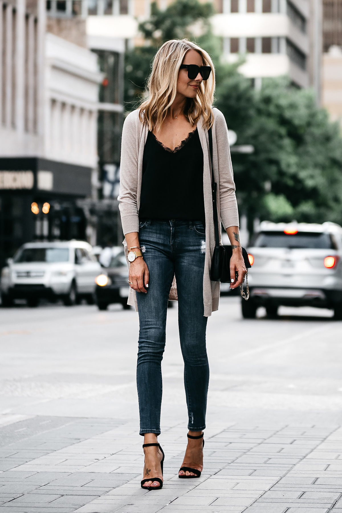 Blonde Woman Wearing Long Tan Cardigan Black Lace Cami Denim Skinny Jeans Outfit Black Ankle Strap Heeled Sandals Fashion Jackson Dallas Blogger Fashion Blogger