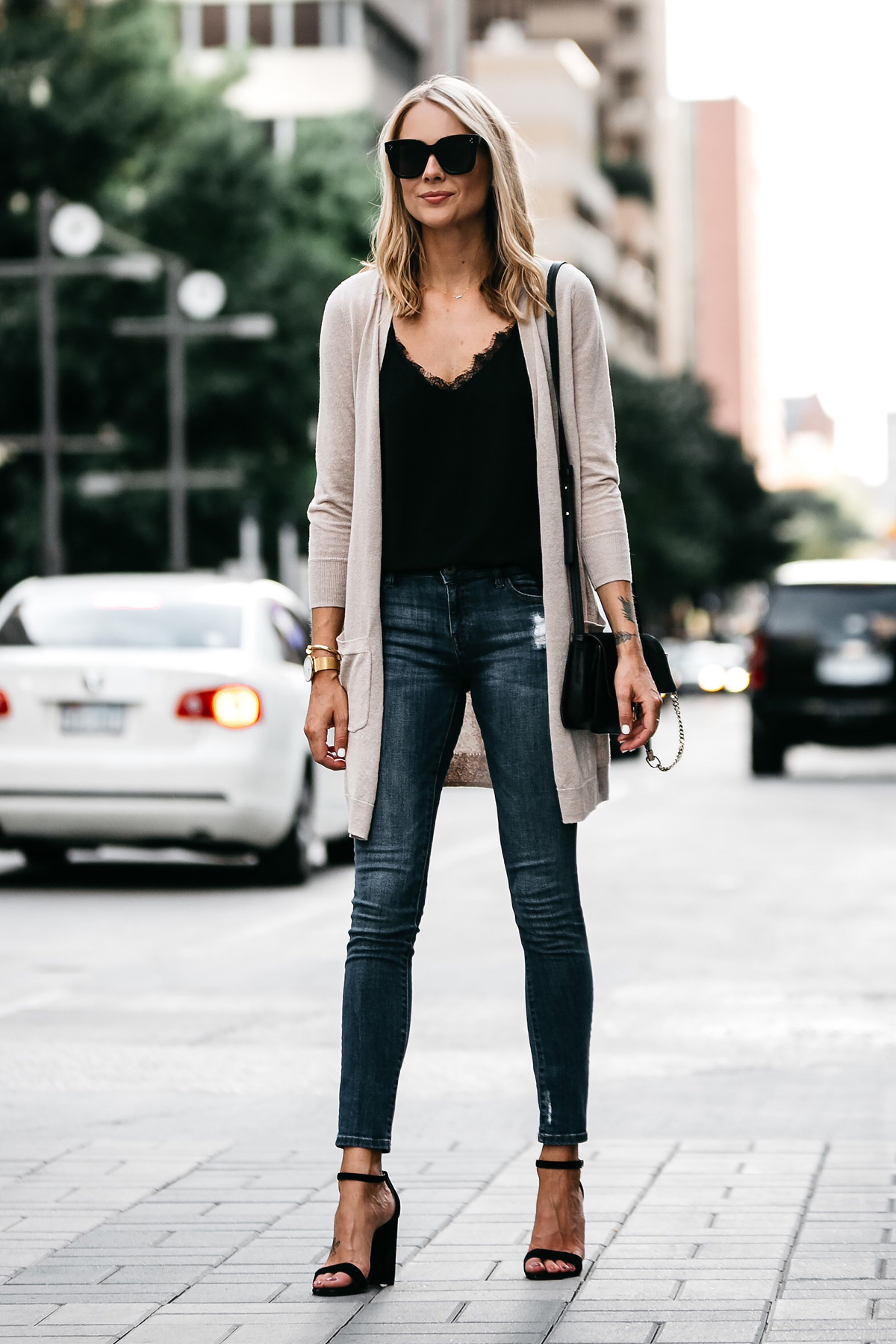 Blonde Woman Wearing Long Tan Cardigan Black Lace Cami Denim Skinny Jeans Outfit Black Ankle Strap Heeled Sandals Fashion Jackson Dallas Blogger Fashion Blogger