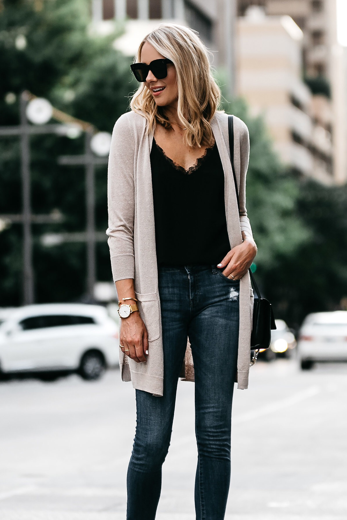 Blonde Woman Wearing Long Tan Cardigan Black Lace Cami Denim Skinny Jeans Outfit Fashion Jackson Dallas Blogger Fashion Blogger