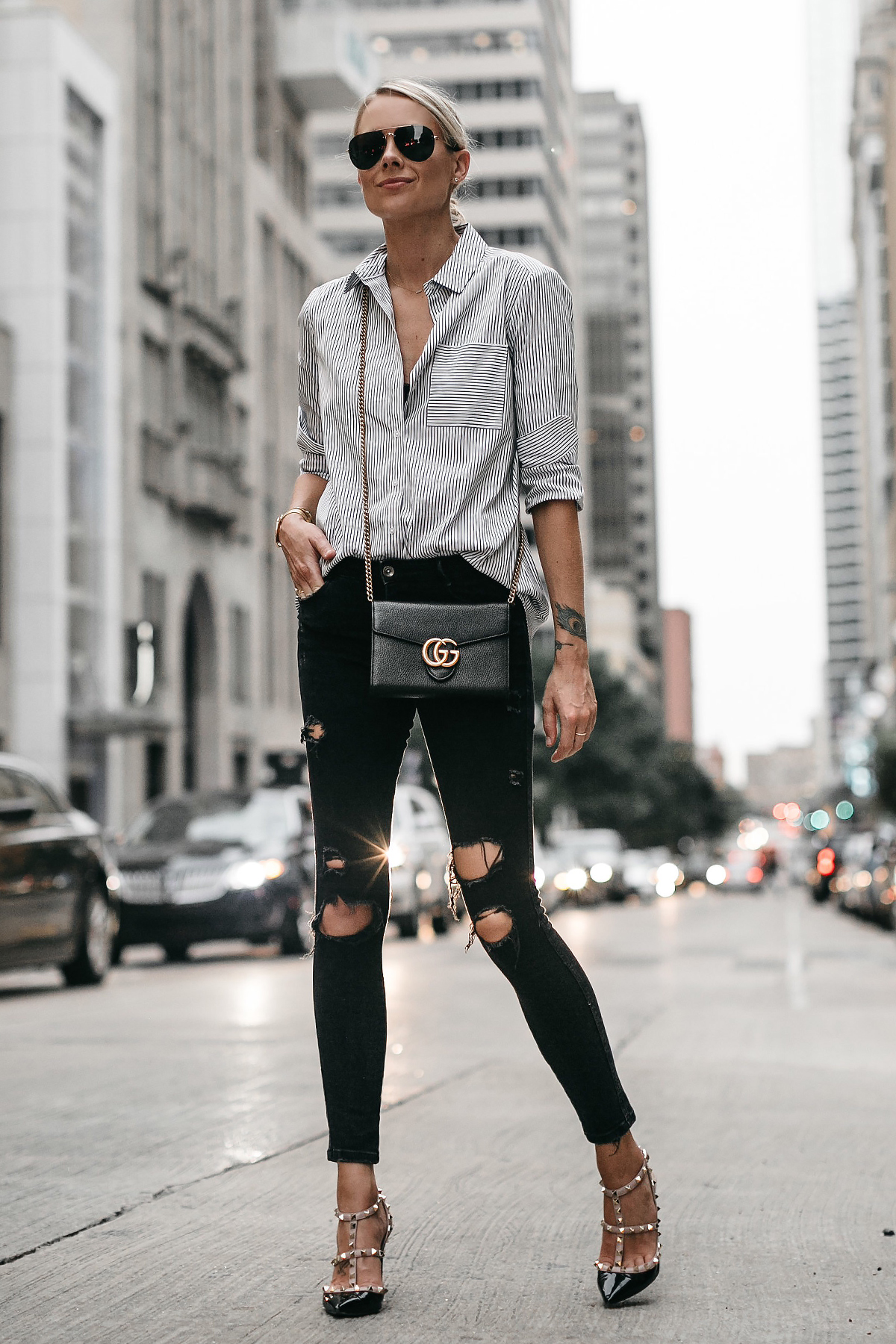 68e23541 Blonde Woman Wearing Striped Button Down Shirt Black Ripped Skinny Jeans  Gucci Handbag Valentino Rockstud Pumps