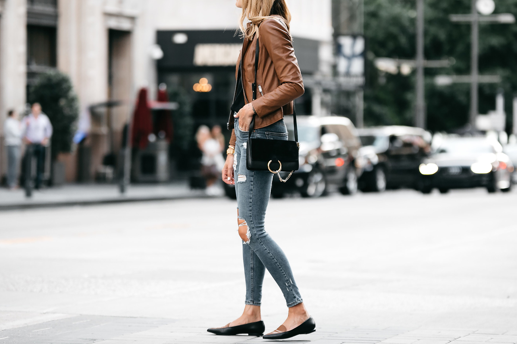 Blonde Woman Wearing Tan Leather Jacket Black Tshirt Denim Ripped Skinny Jeans Outfit Black Tan Loafers Chloe Faye Handbag Fashion Jackson Dallas Blogger Fashion Blogger Street Style