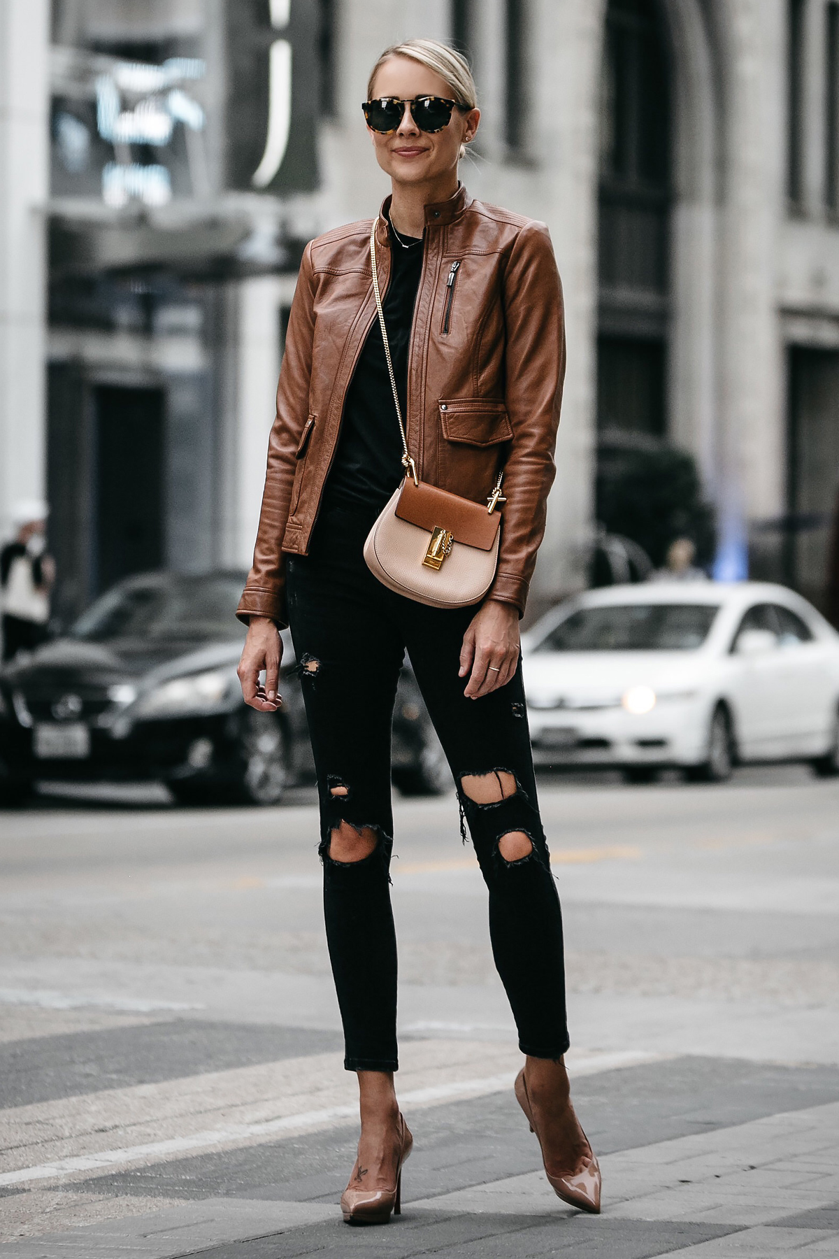 Blonde Woman Wearing Tan Leather Moto Jacket Black Ripped Skinny Jeans Outfit Chloe Drew Handbag Christin Louboutin Nude Pumps Fashion Jackson Dallas Blogger Fashion Blogger Street Style