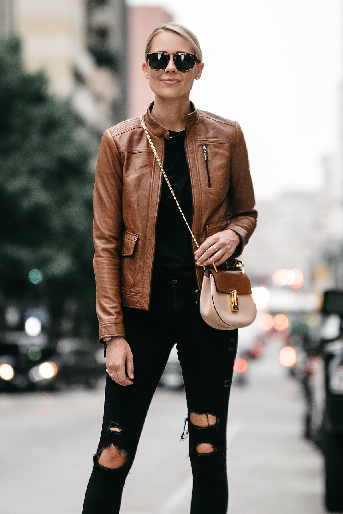 Blonde Woman Wearing Tan Leather Moto Jacket Black Ripped Skinny Jeans Outfit Chloe Drew Handbag Fashion Jackson Dallas Blogger Fashion Blogger Street Style