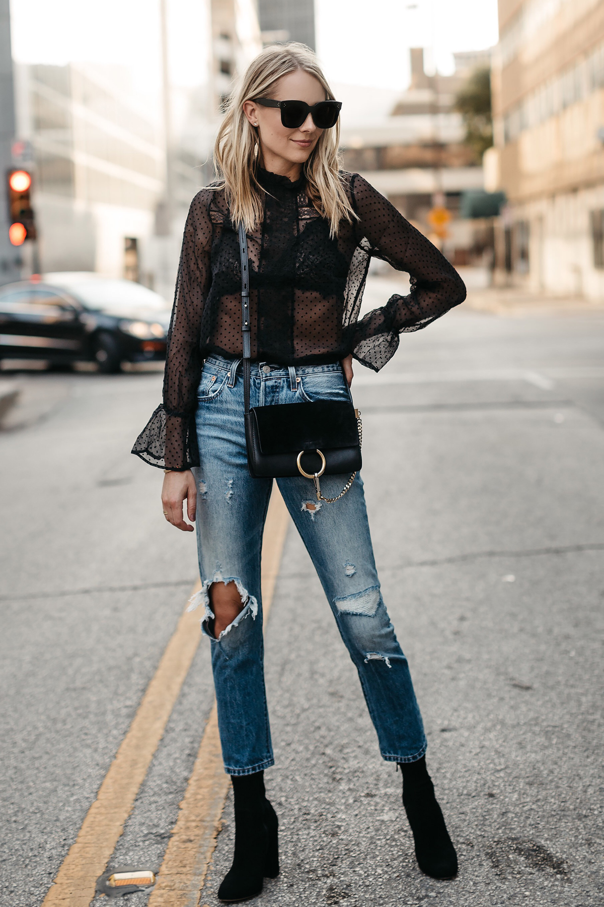 Blonde Woman Wearing Anine Bing Black Lace Top Chloe Faye Black Handbag Denim Ripped Jeans Club Monaco Black Ankle Booties Fashion Jackson Dallas Blogger Fashion Blogger Street Style
