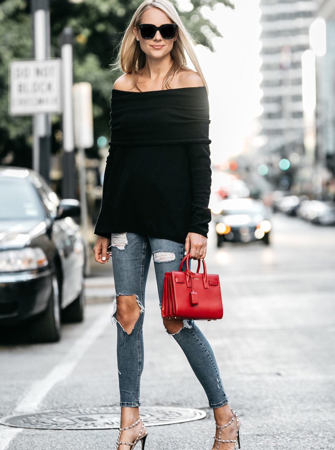Blonde Woman Wearing Black off the shoulder Sweater Denim Ripped Skinny Jeans Valentino Rockstud Pumps Saint Laurent Red Sac De Jour Handbag Fashion Jackson Dallas Blogger Fashion Blogger Street Style