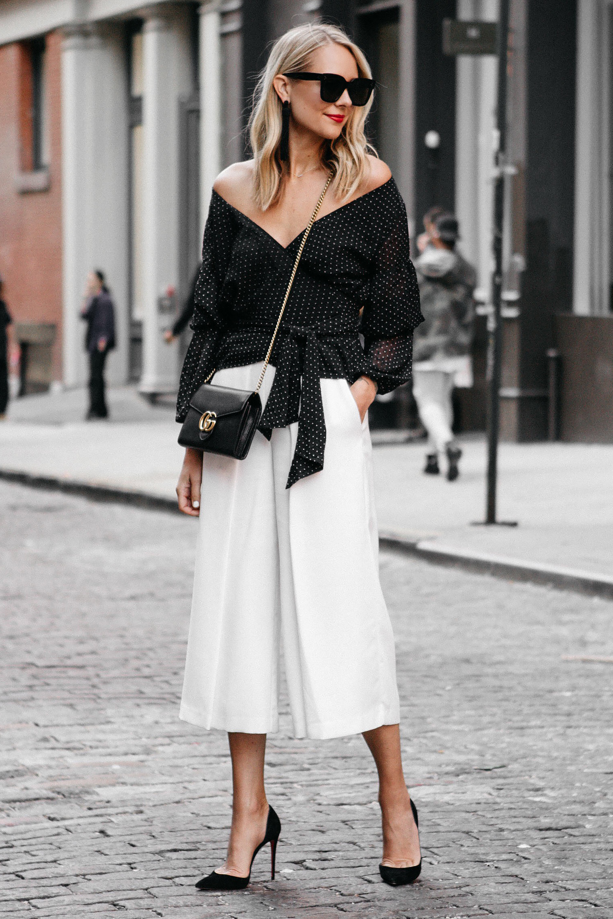 Blonde Woman Wearing Club Monaco Black Wrap Top White Culottes Gucci Marmont Handbag Christian Louboutin Black Pumps Fashion Jackson Dallas Blogger Fashion Blogger Street Style NYFW