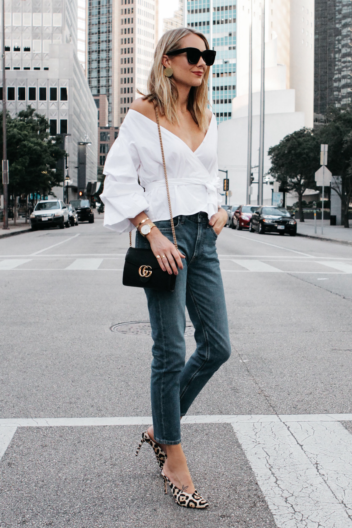 Blonde Woman Wearing Club Monaco White Ruffle Sleeve Wrap Top Gucci Marmont Handbag Everlane Boyfriend Jeans Club Monaco Leopard Heels Fashion Jackson Dallas Blogger Fashion Blogger Street Style