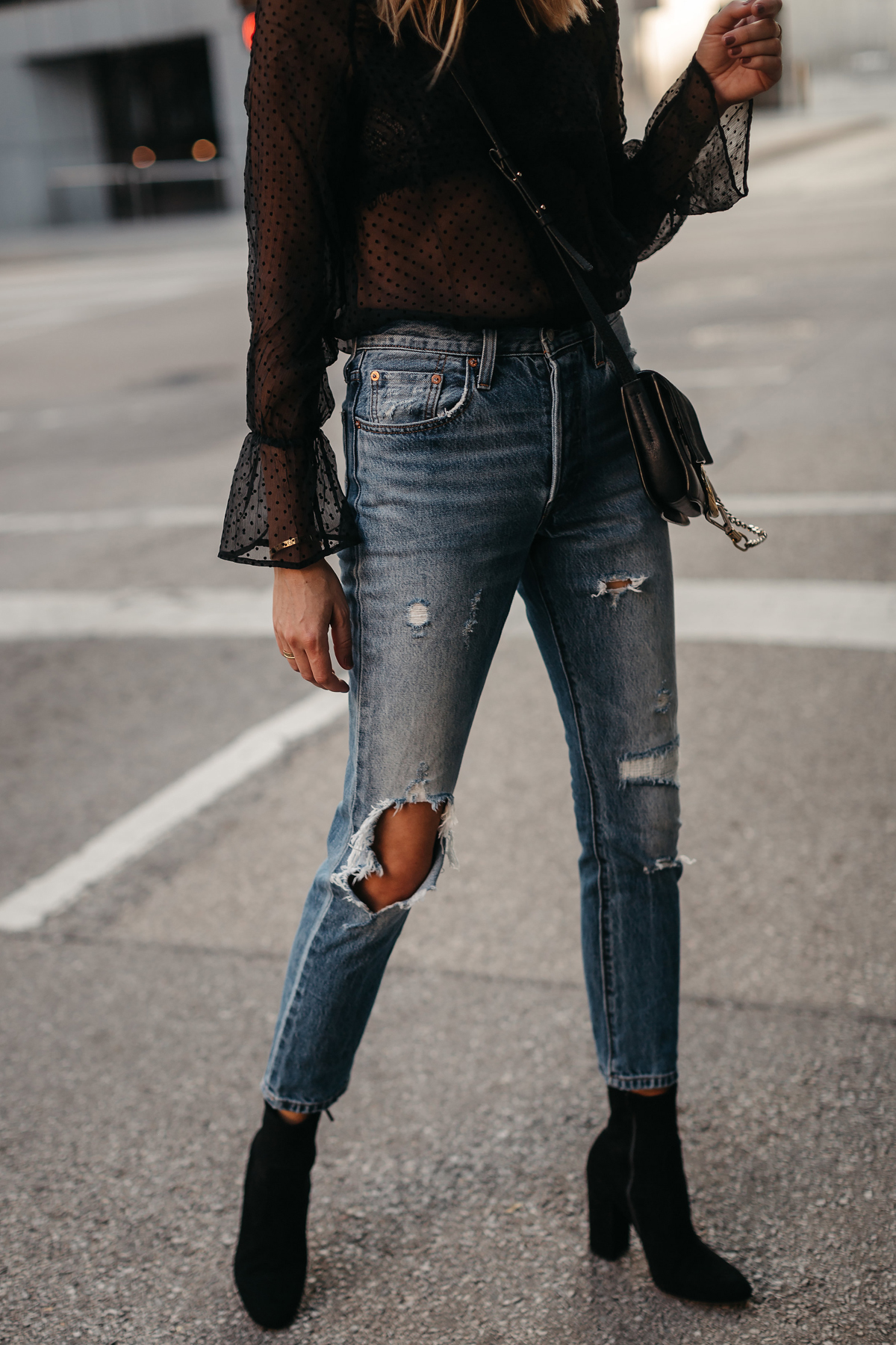 Levis Ripped Jeans Club Monaco Black Ankle Booties Black Lace Top Fashion Jackson Dallas Blogger Fashion Blogger Street Style