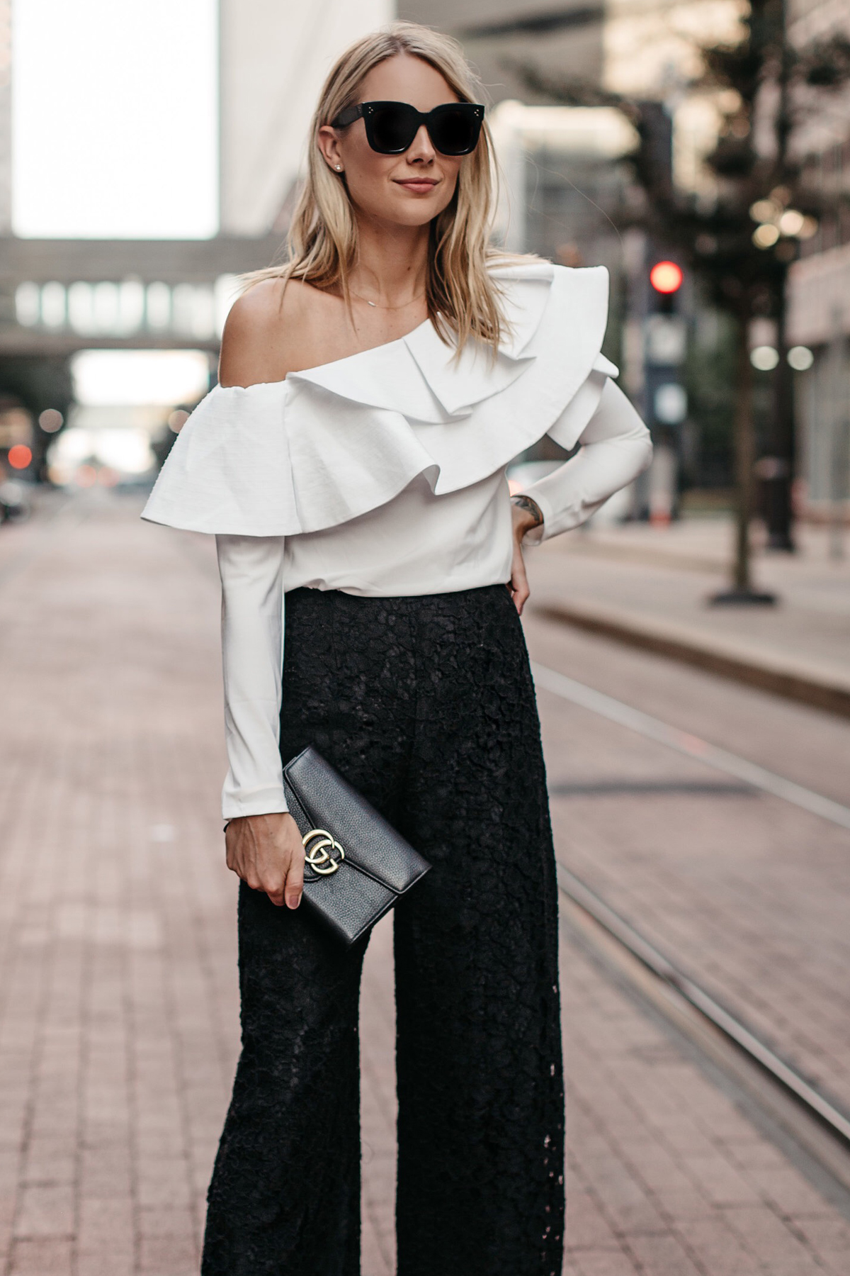 Blonde Woman Wearing White One Shoulder Ruffle Top Black Lace Culottes Gucci Marmont Handbag Fashion Jackson Dallas Blogger Fashion Blogger Street Style