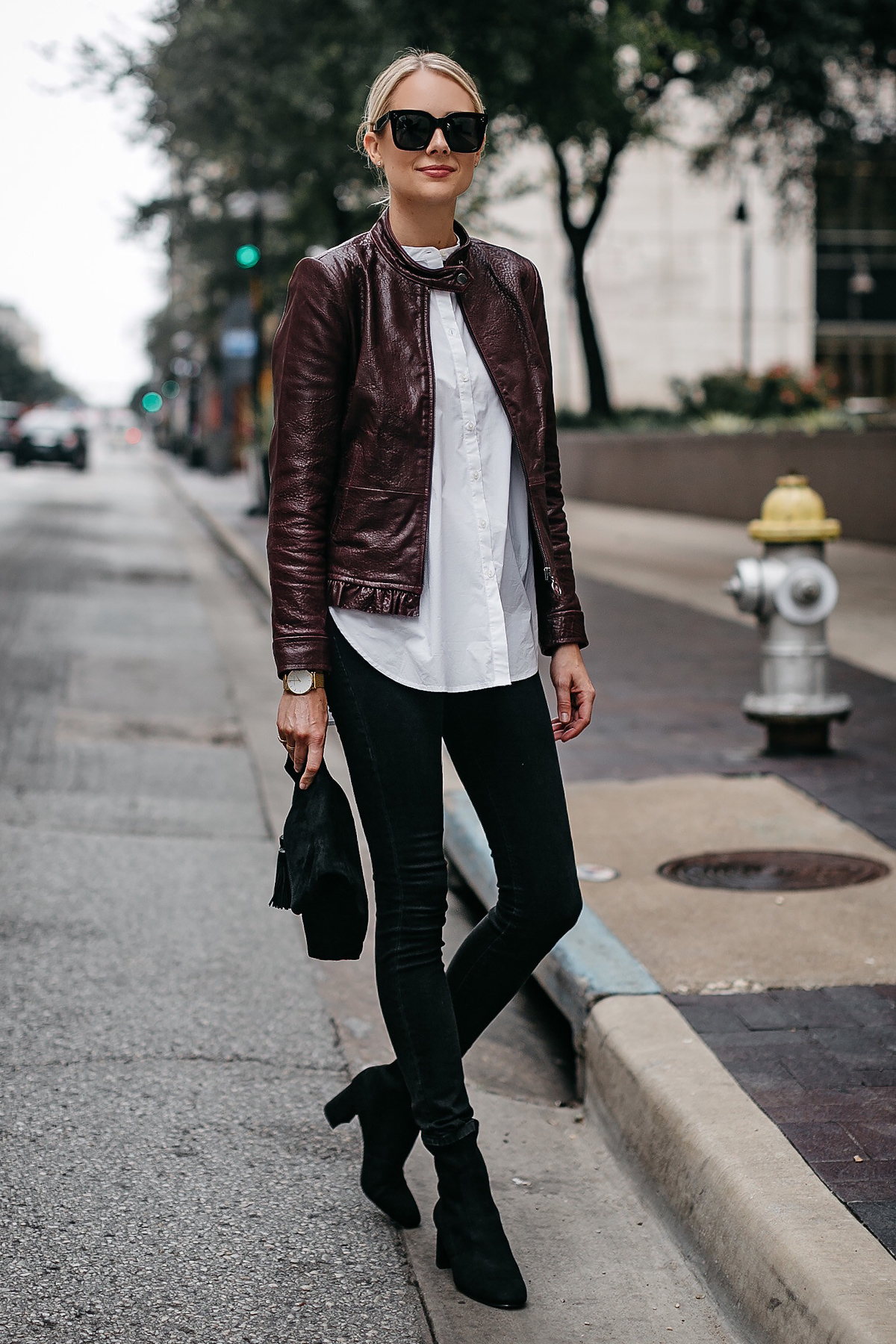 Blonde Woman Wearing Ann Taylor Luxewear Moto Leather Jacket White Shirt Black Skinny Jeans Black Ankle Booties Black Clutch Fashion Jackson Dallas Blogger Fashion Blogger Street Style