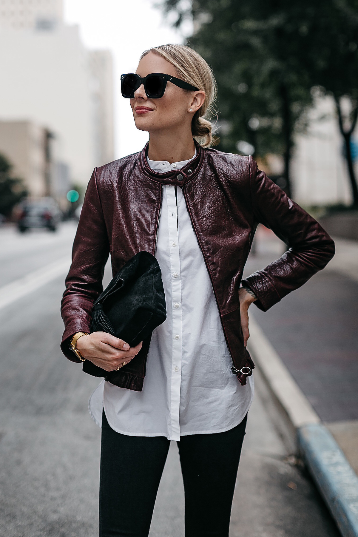 Blonde Woman Wearing Ann Taylor Luxewear Moto Leather Jacket White Shirt Black Skinny Jeans Black Clutch Fashion Jackson Dallas Blogger Fashion Blogger Street Style
