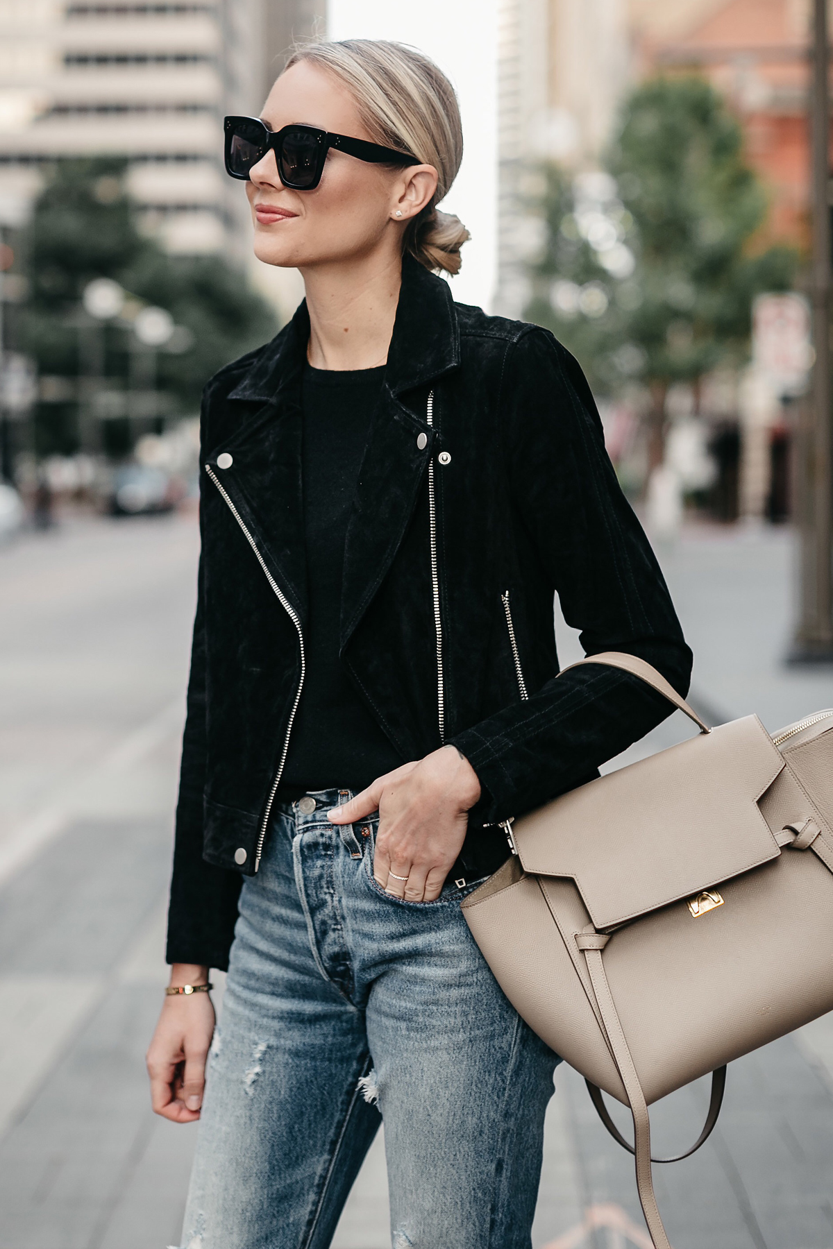 Blonde Woman Wearing Black Suede Moto Jacket Black Sweater Denim Ripped Jeans Celine Mini Belt Bag Fall-Fashion Must Haves Fashion Jackson Dallas Blogger Fashion Blogger Street Style