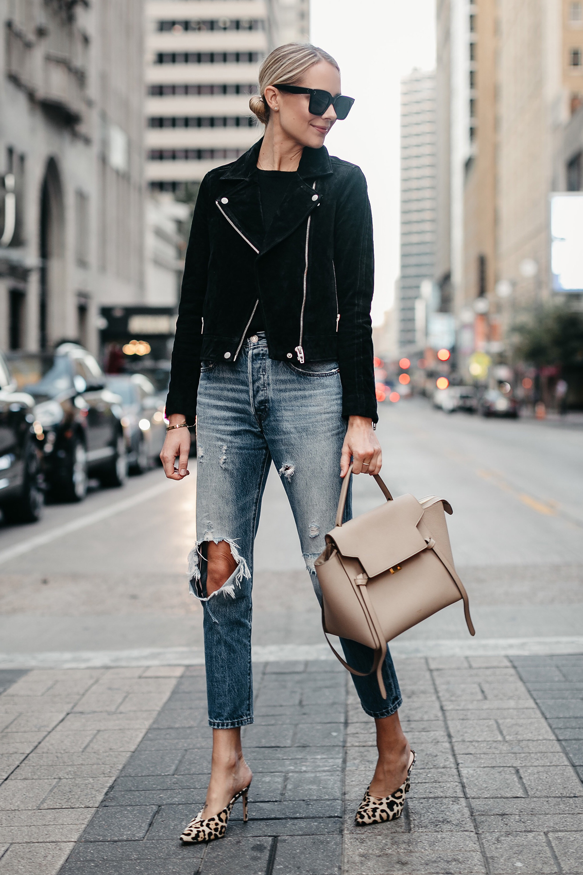 Blonde Woman Wearing Black Suede Moto Jacket Black Sweater Denim Ripped Jeans Celine Mini Belt Bag Leopard Heels Fall-Fashion Must Haves Fashion Jackson Dallas Blogger Fashion Blogger Street Style