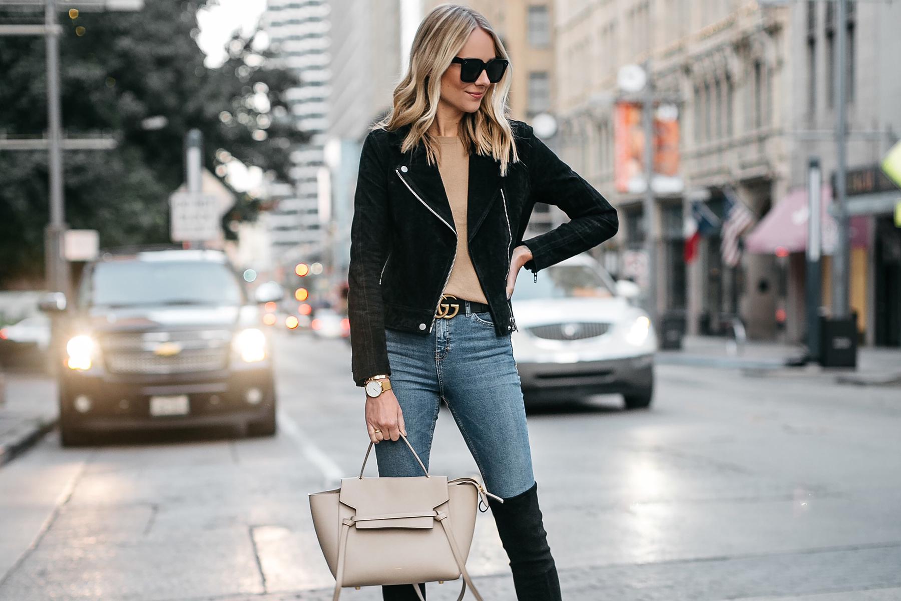 db553dba42c Blonde Woman Wearing Black Suede Moto Jacket Camel Sweater Denim Skinny  Jeans Celine Mini Belt Bag