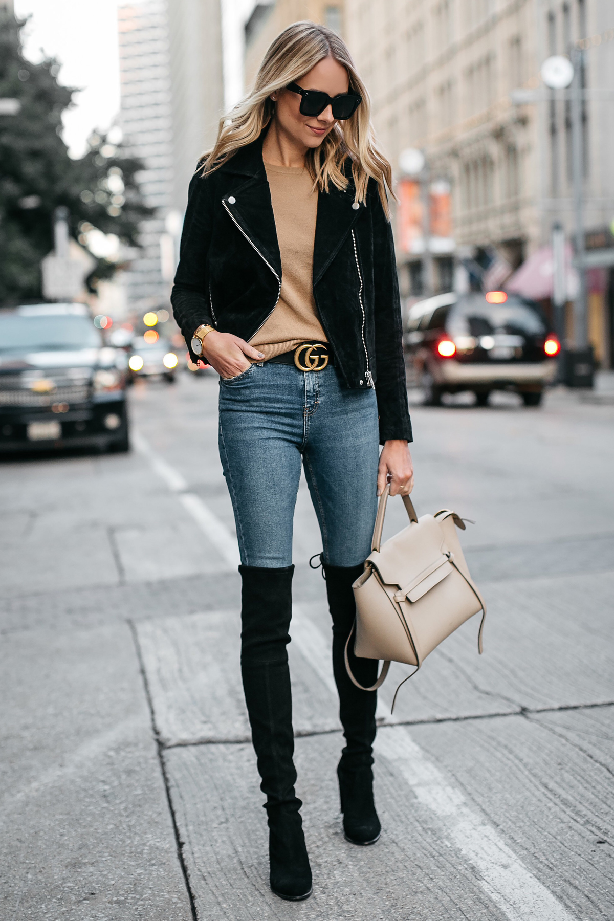 7be43e820c5 Blonde Woman Wearing Black Suede Moto Jacket Camel Sweater Denim Skinny  Jeans Stuart Weitzman Over-