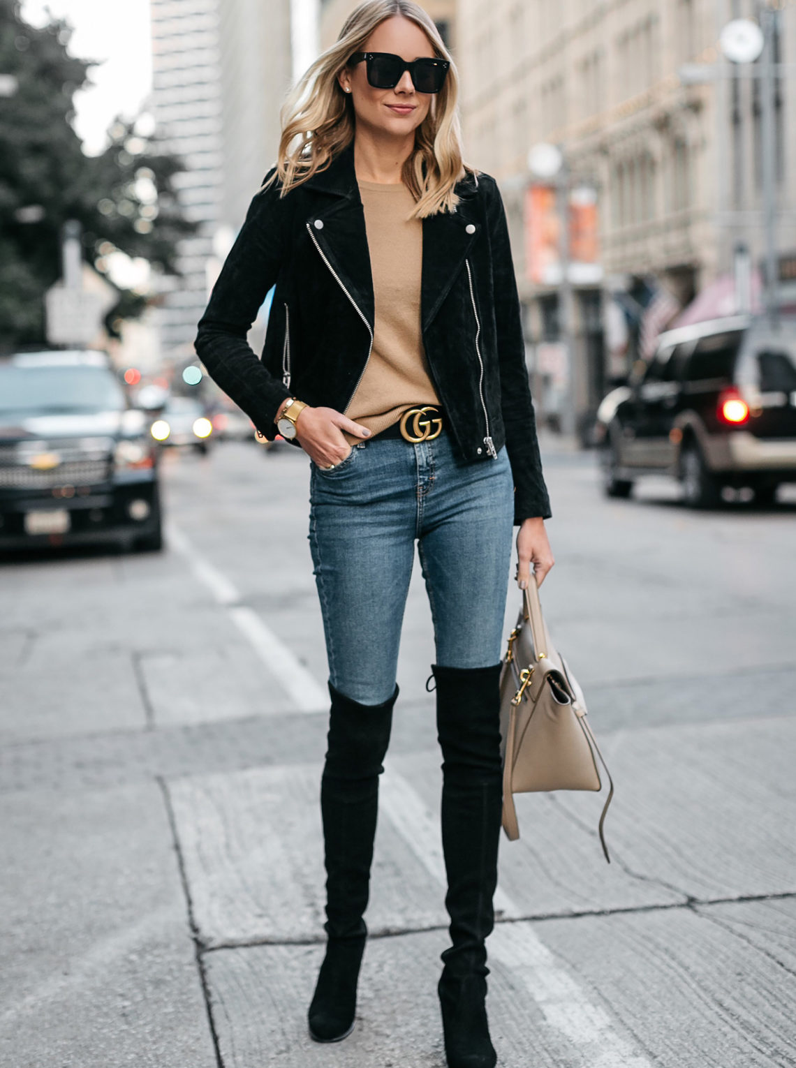 Blonde Woman Wearing Black Suede Moto Jacket Camel Sweater Denim Skinny Jeans Stuart Weitzman Over-the-Knee boots Gucci Marmont Belt Fashion Jackson Dallas Blogger Fashion Blogger Street Style