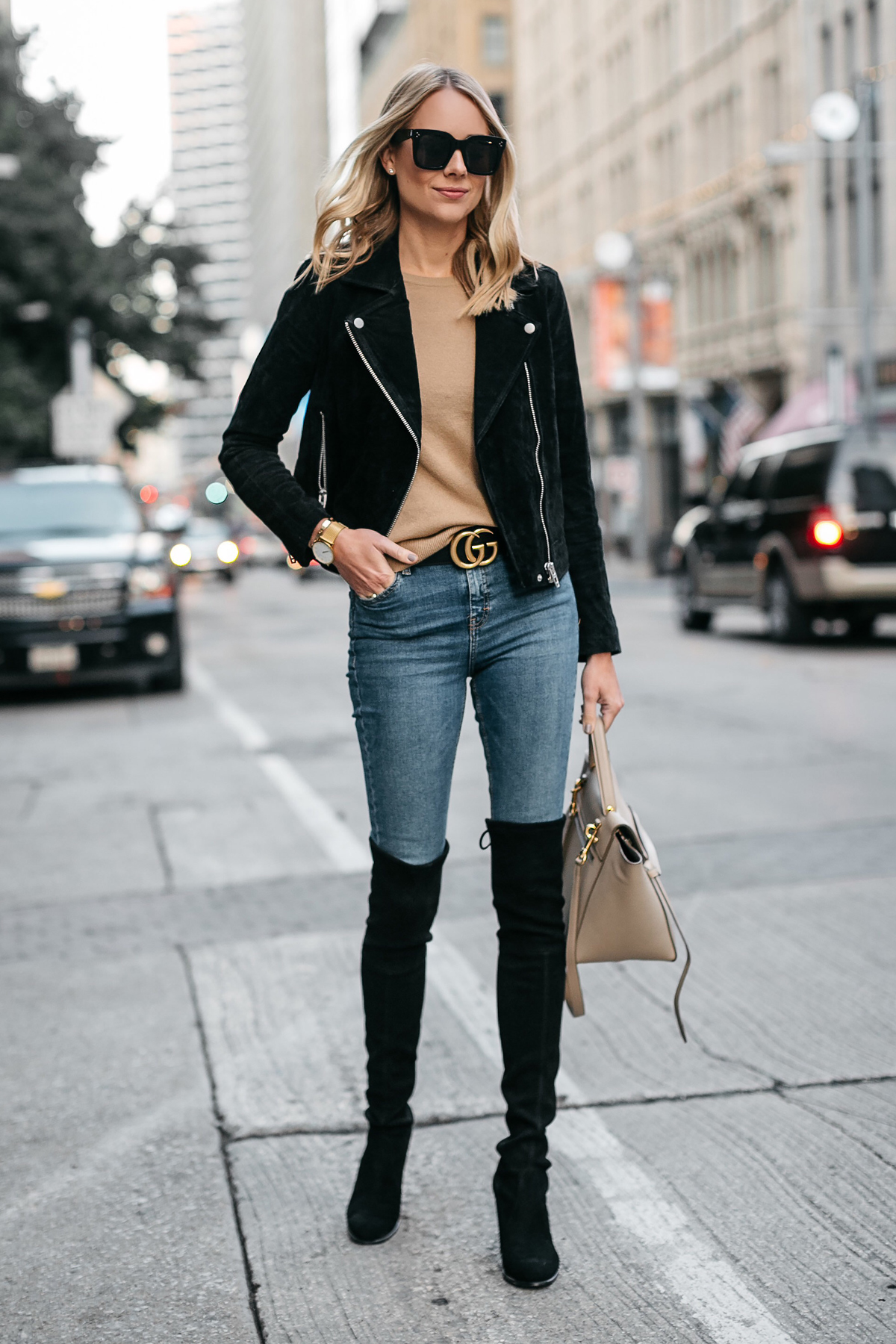 f9e11759845 Blonde Woman Wearing Black Suede Moto Jacket Camel Sweater Denim Skinny  Jeans Stuart Weitzman Over-