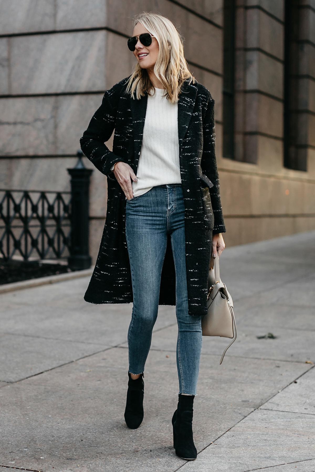 Blonde Woman Wearing Black Sweater Coat White Sweater Denim Skinny Jeans Black Booties Fashion Jackson Dallas Blogger Fashion Blogger Street Style