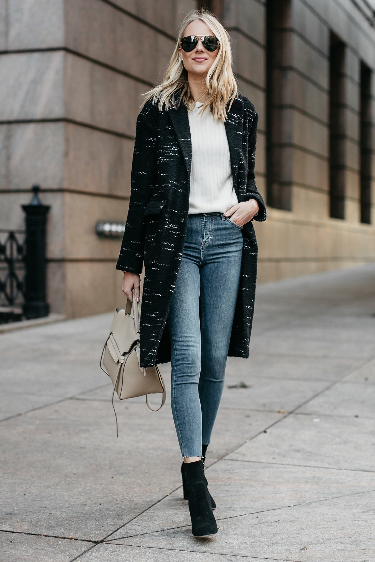 Blonde Woman Wearing Black Sweater Coat White Sweater Denim Skinny Jeans Black Booties Celine Mini Belt Bag Fashion Jackson Dallas Blogger Fashion Blogger Street Style