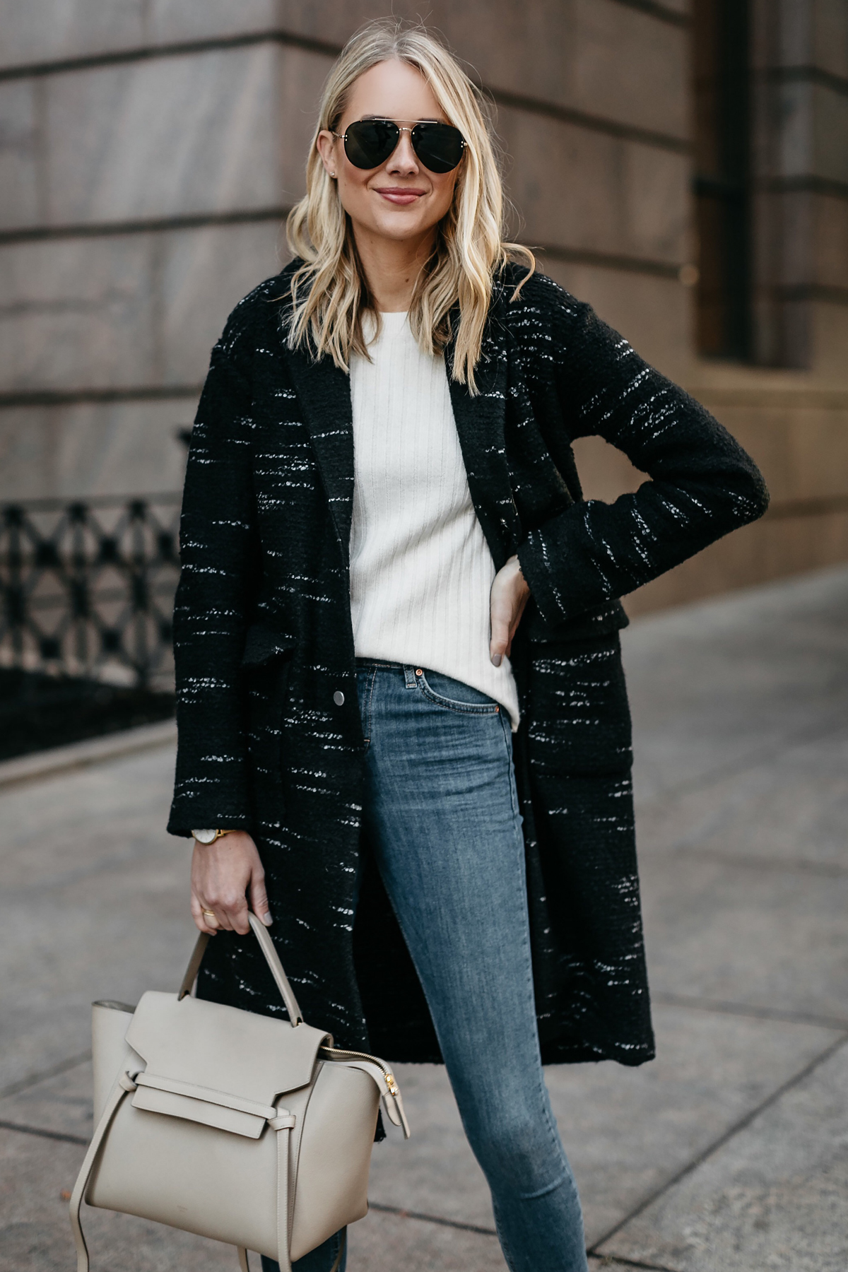 Blonde Woman Wearing Black Sweater Coat White Sweater Denim Skinny Jeans Celine Mini Belt Bag Fashion Jackson Dallas Blogger Fashion Blogger Street Style