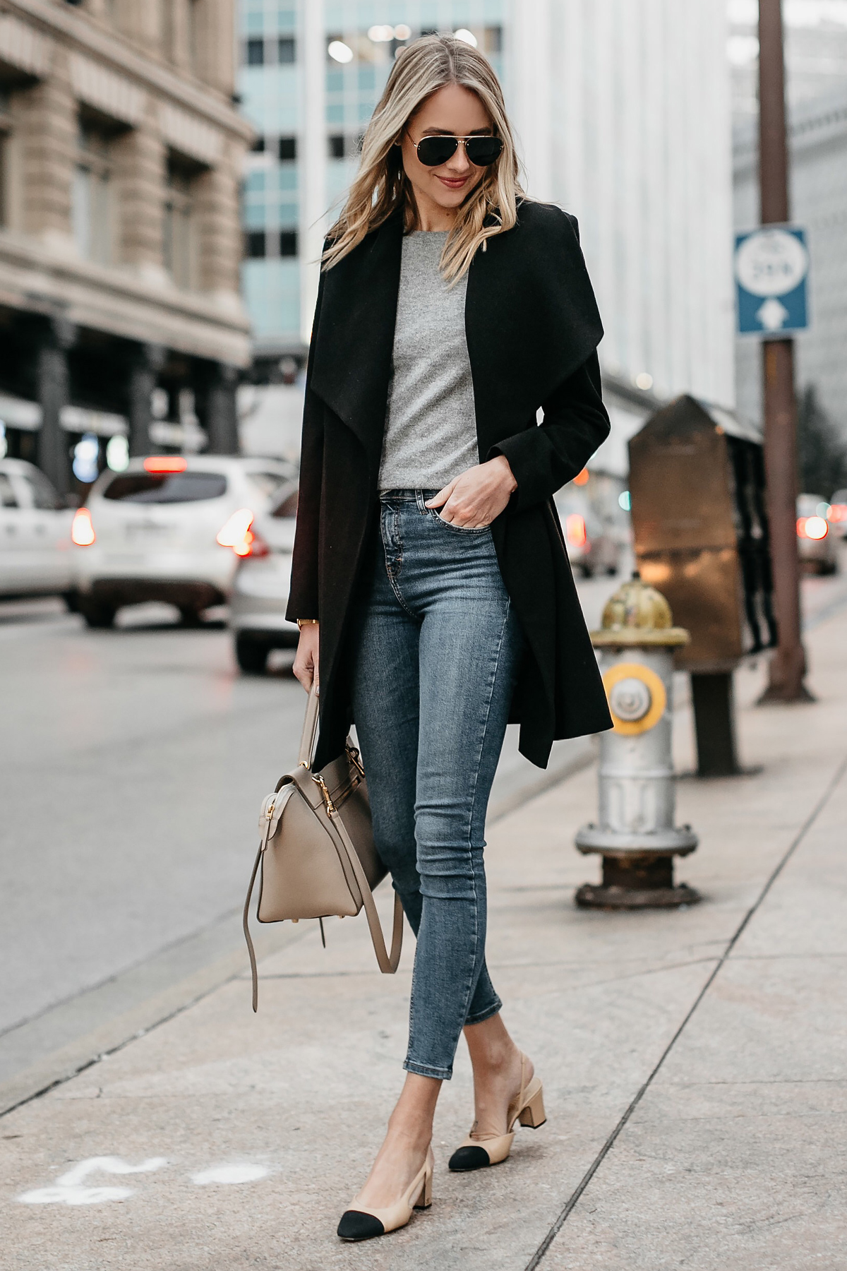 Blonde Woman Wearing Black Wrap Coat Grey Sweater Denim Skinny Jeans Chanel Slingbacks Celine MIni Belt Bag Fashion Jackson Dallas Blogger Fashion Blogger Street Style