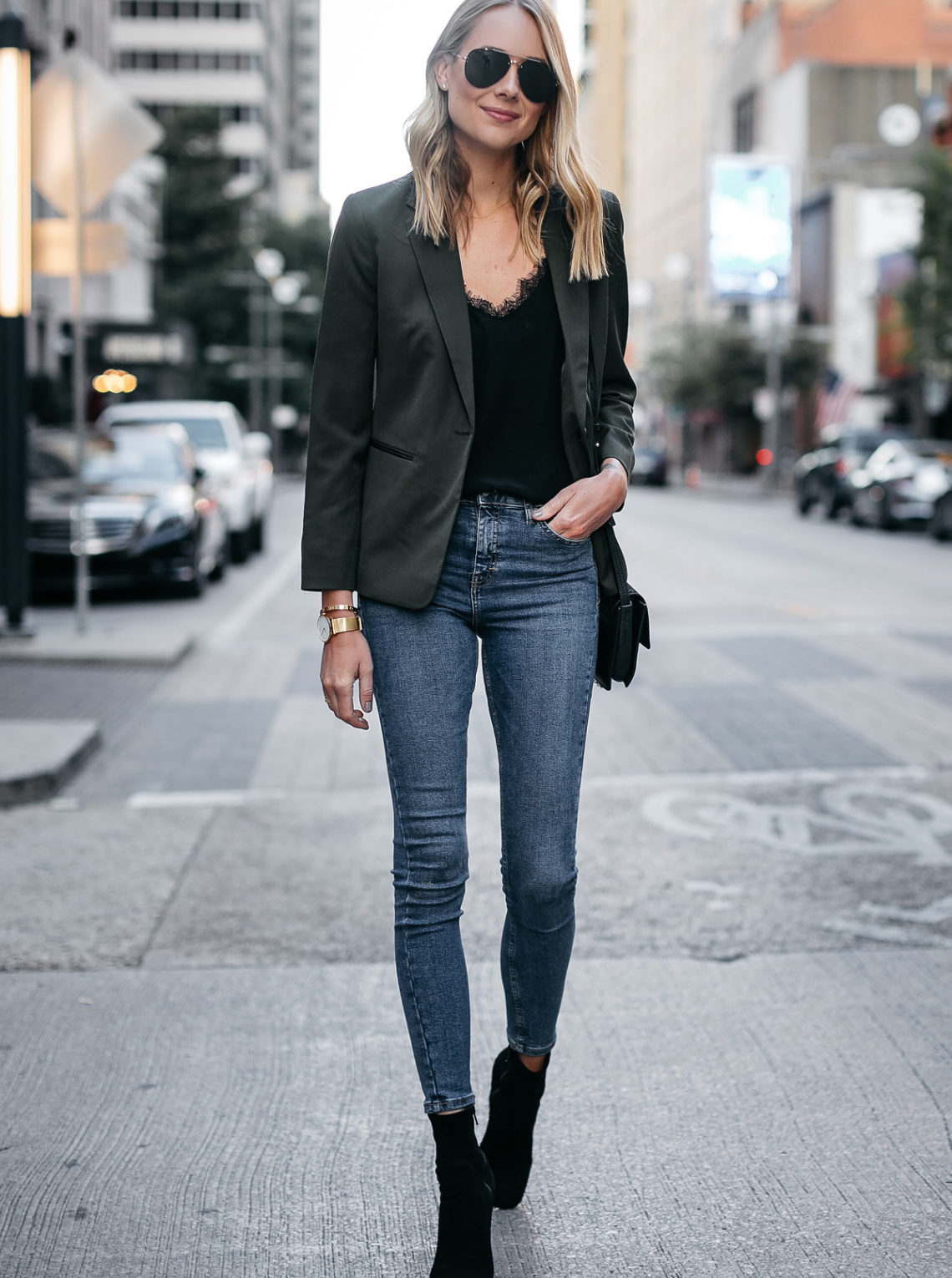 Blonde Woman Wearing Everlane Green Blazer Anine Bing Black Lace Cami Topshop Denim Skinny Jeans Club Monaco Black Booties Fashion Jackson Dallas Blogger Fashion Blogger Street Style