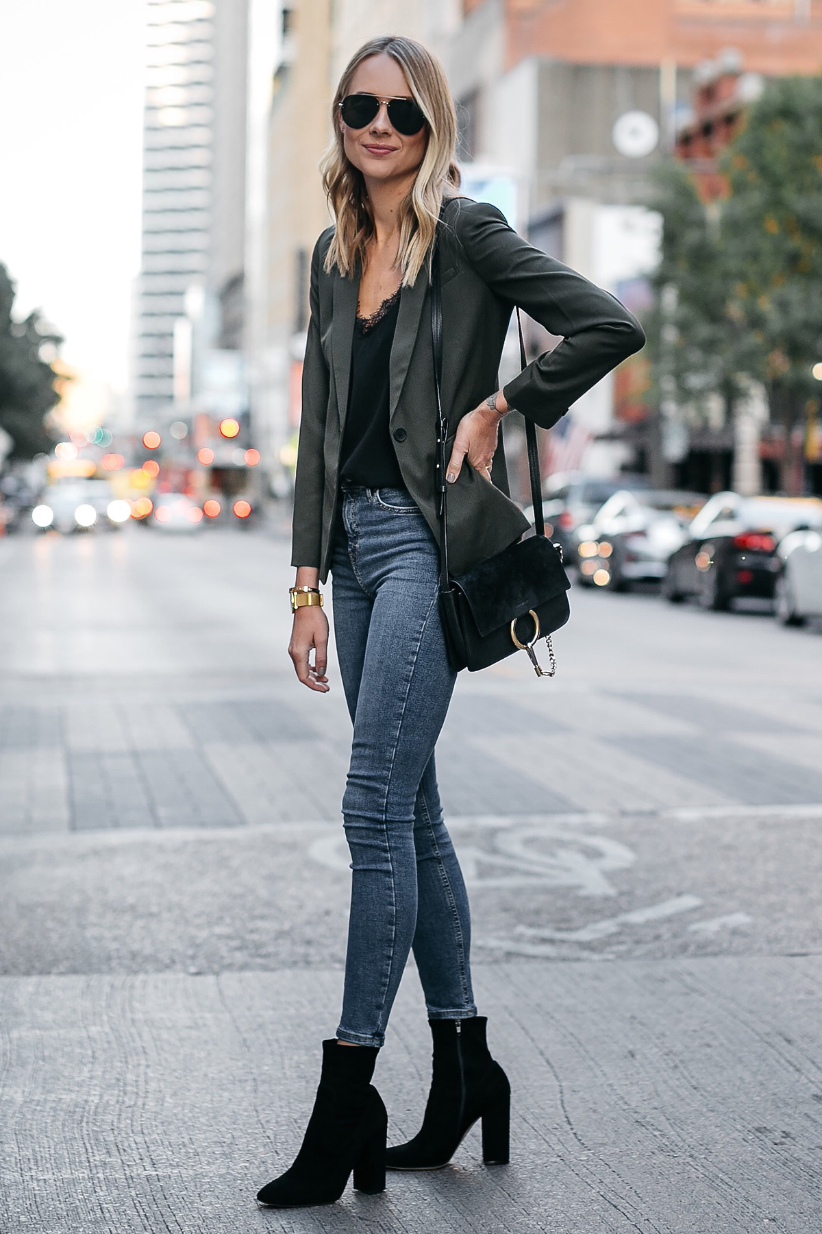 Blonde Woman Wearing Everlane Olive Green Blazer Anine Bing Black Lace Cami Topshop Denim Skinny Jeans Club Monaco Black Booties Chloe Faye Black Handbag Fashion Jackson Dallas Blogger Fashion Blogger Street Style