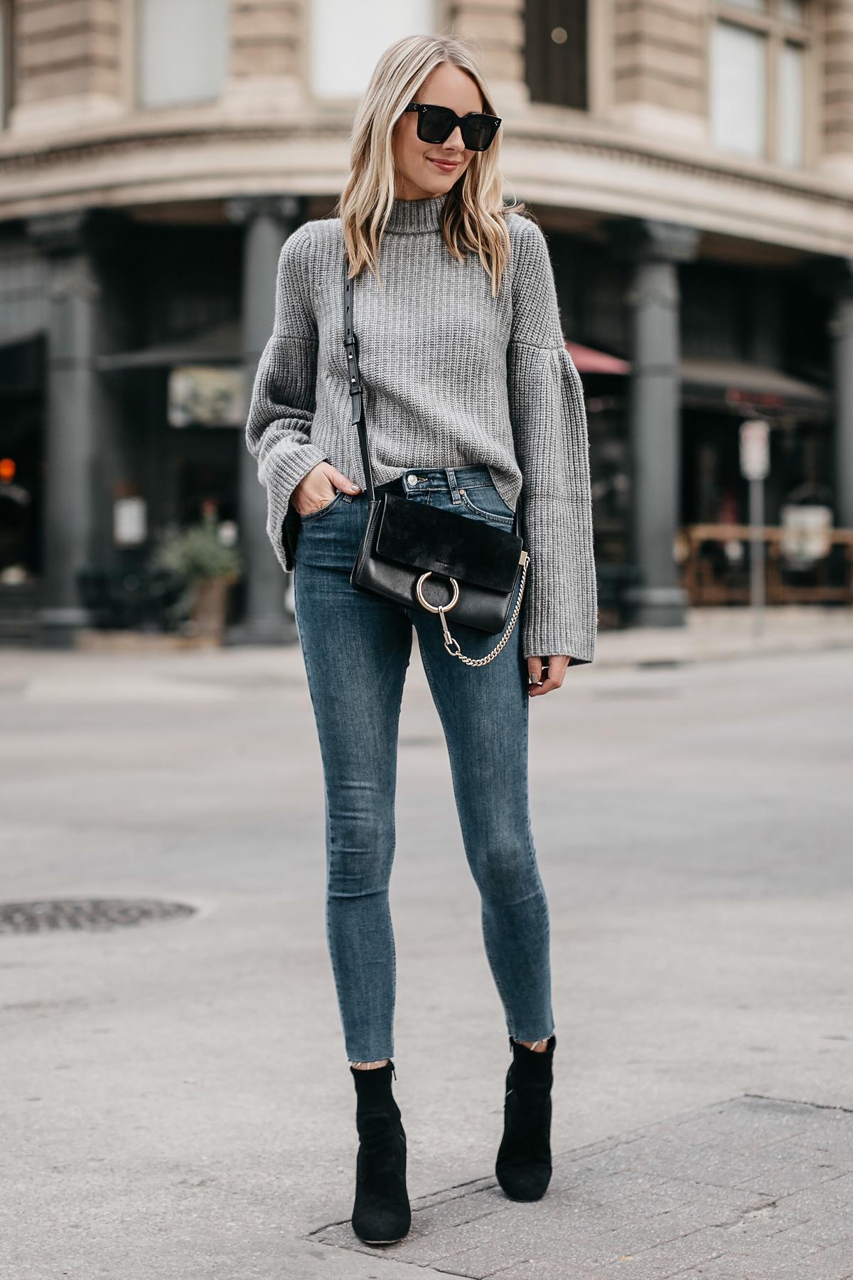 Blonde Woman Wearing Grey Bell Sleeve Sweater Denim Skinny Jeans Chloe Faye Black Handbag Black Booties Fashion Jackson Dallas Blogger Fashion Blogger Street Style