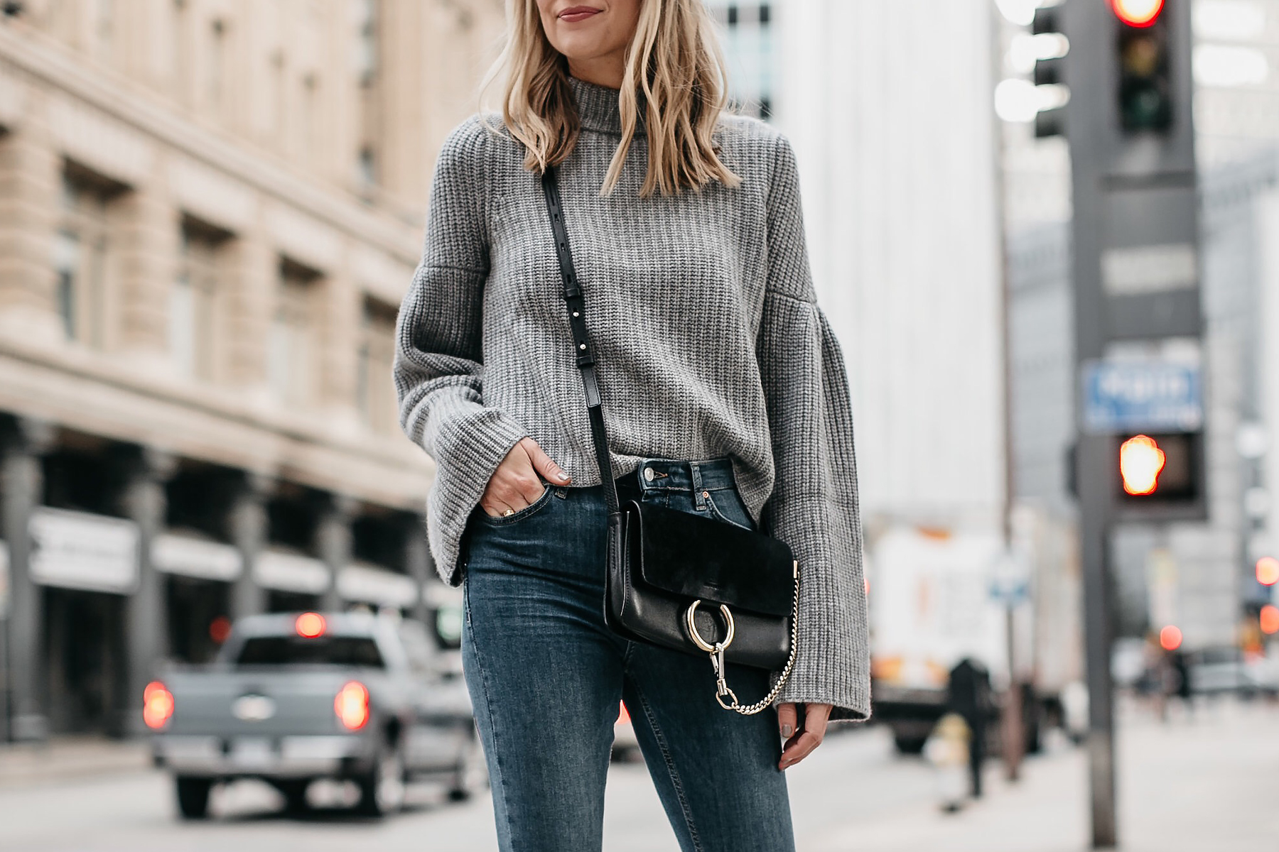 Blonde Woman Wearing Grey Bell Sleeve Sweater Denim Skinny Jeans Chloe Faye Black Handbag Fashion Jackson Dallas Blogger Fashion Blogger Street Style