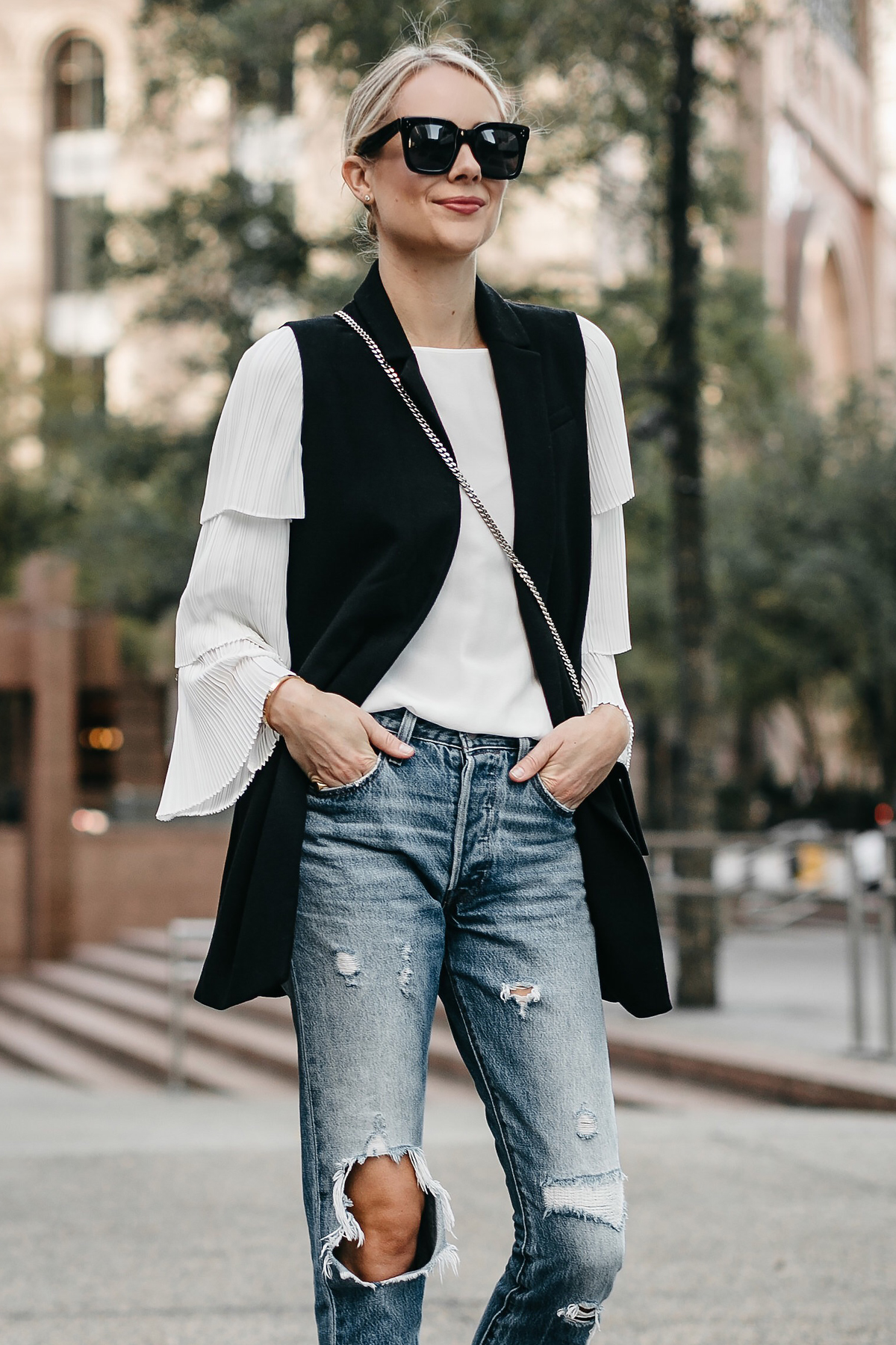 Blonde Woman Wearing Long Black Vest White Pleat Sleeve Top Denim Ripped Jeans Fashion Jackson Dallas Blogger Fashion Blogger Street Style