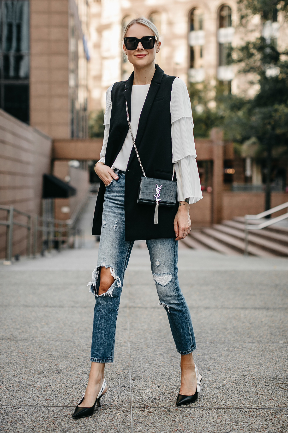 Blonde Woman Wearing Long Black Vest White Pleat Sleeve Top Denim Ripped Jeans Dior Slingbacks Saint Laurant Monogram Crossbody Fashion Jackson Dallas Blogger Fashion Blogger Street Style