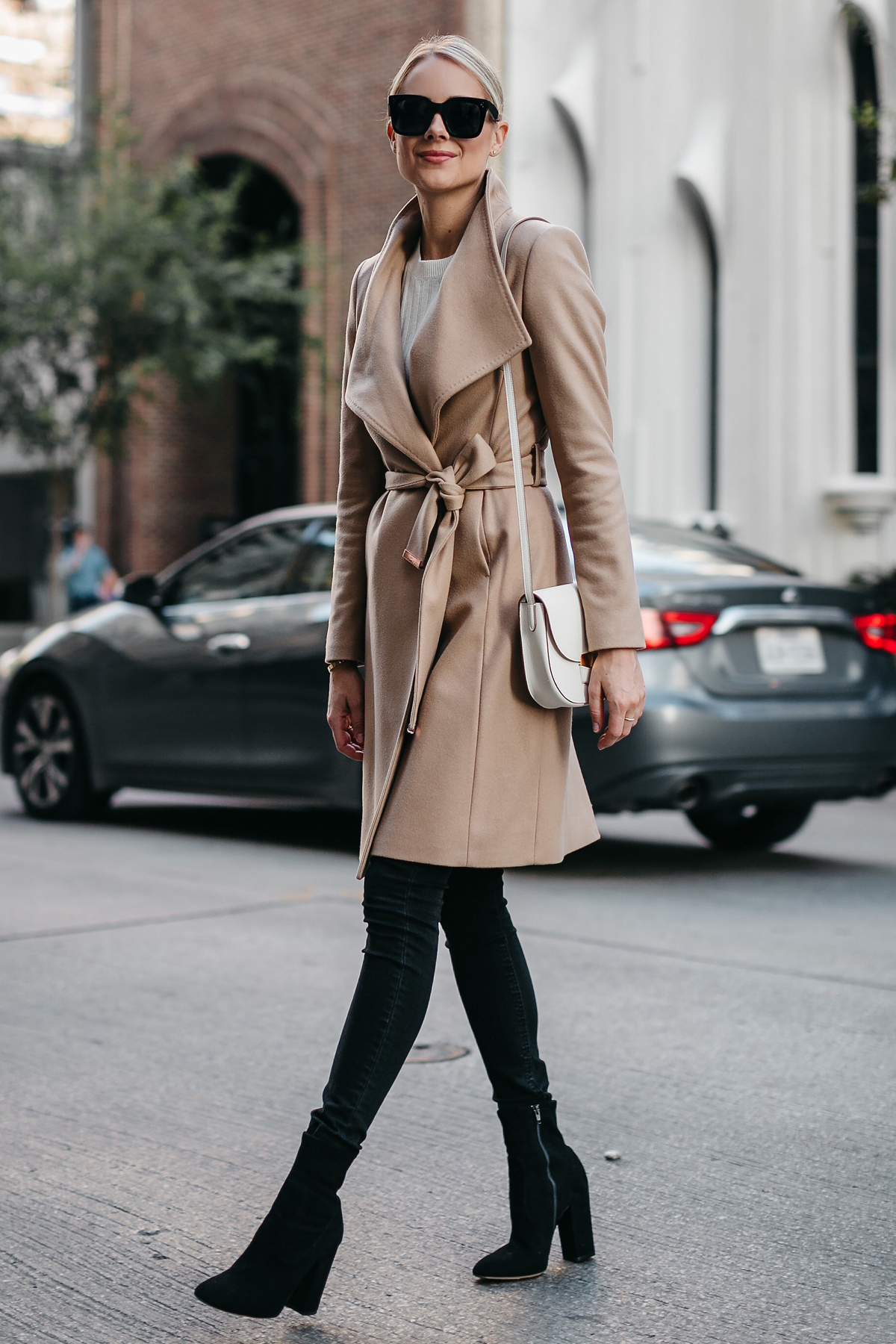 Blonde Woman Wearing Tan Wrap Coat Black Skinny Jeans Black Booties Outfit Fashion Jackson Dallas Blogger Fashion Blogger Street Style