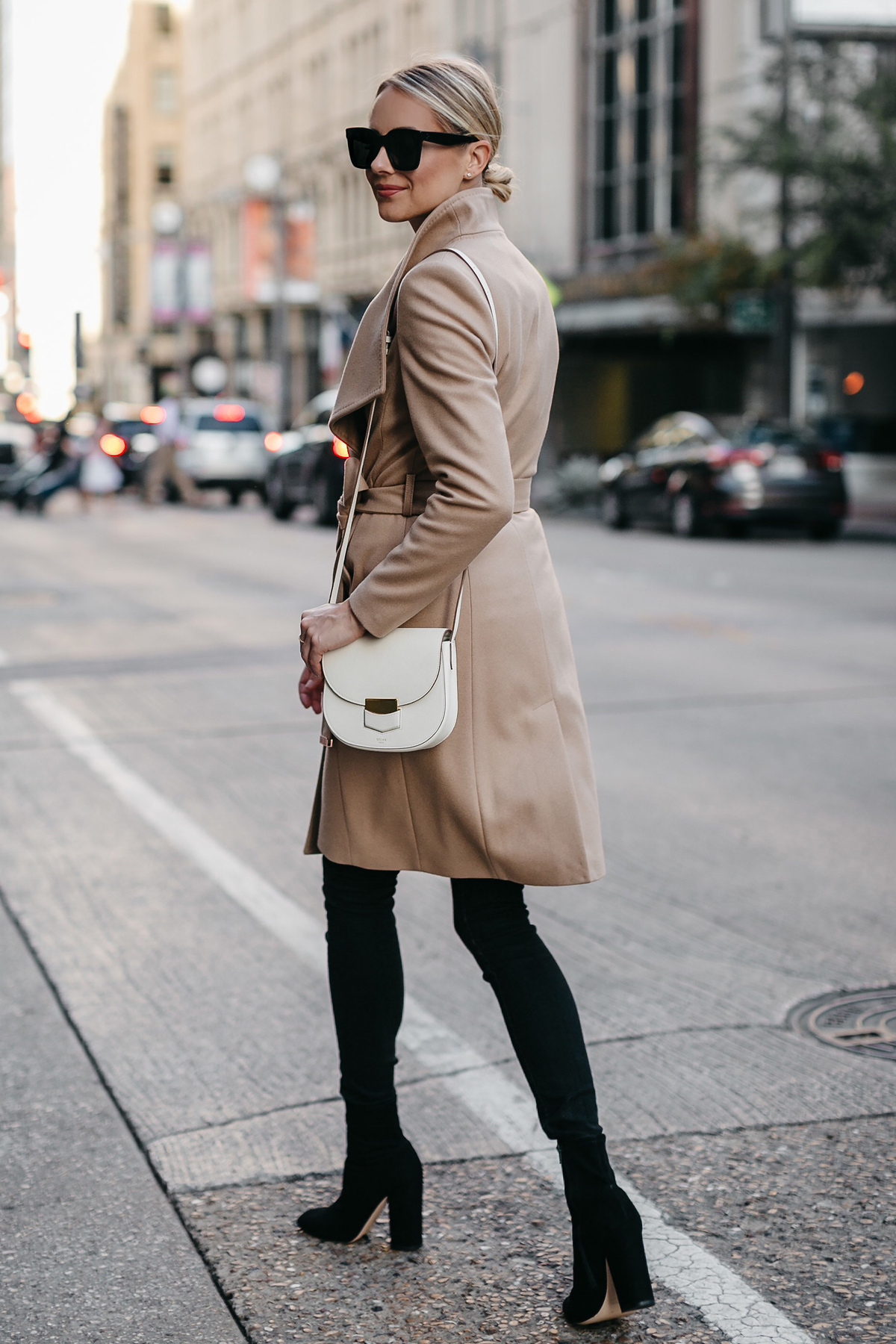 Blonde Woman Wearing Tan Wrap Coat Black Skinny Jeans Black Booties Celine White Trotteur Handbag Fashion Jackson Dallas Blogger Fashion Blogger Street Style